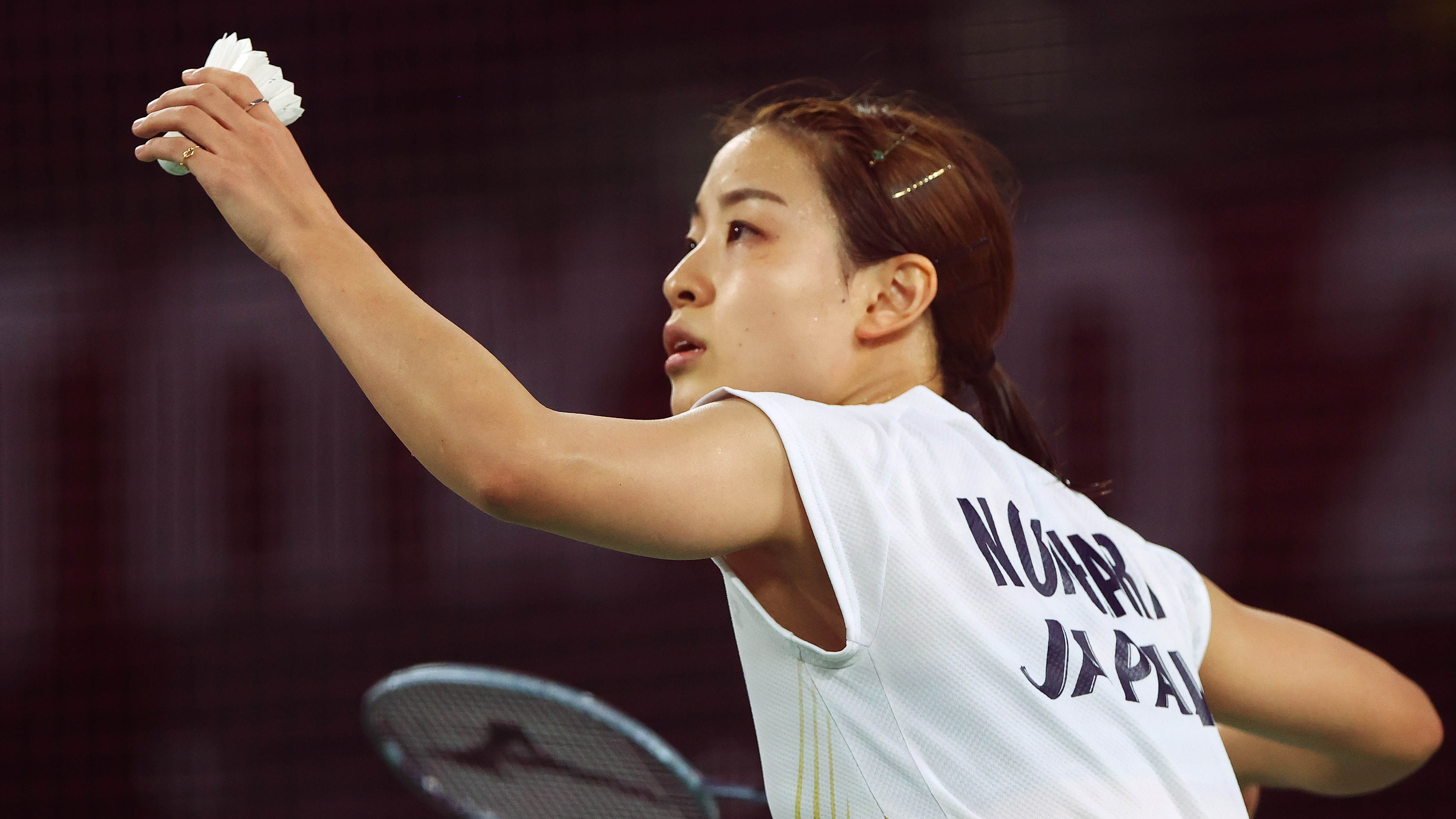 Tokyo 2020 Olympics - Badminton - Women's Singles - Last 16 - MFS - Musashino Forest Sport Plaza, Tokyo, Japan – July 29, 2021. Nozomi Okuhara of Japan prepares to serve during the match against Michelle Li of Canada. REUTERS/Leonhard Foeger