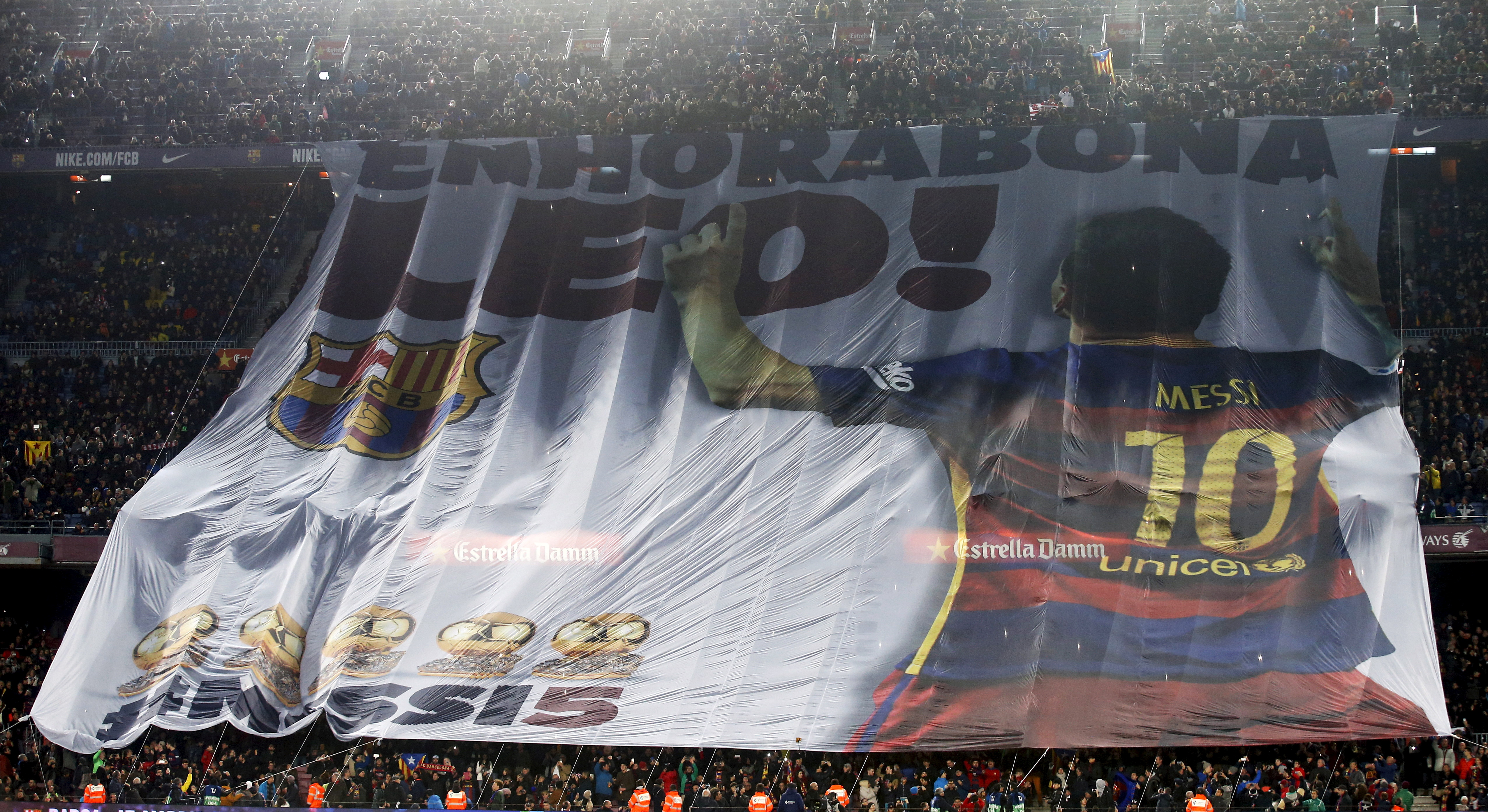 Football Soccer - FC Barcelona v Athletic Bilbao - Spanish Liga - Camp Nou stadium, Barcelona - January 17, 2016 Barcelona's supporters show a giant banner to congratulate Lionel Messi's FIFA Ballon d'Or 2015 trophy before their Spanish League soccer match against Athletic Bilbao. The banner reads