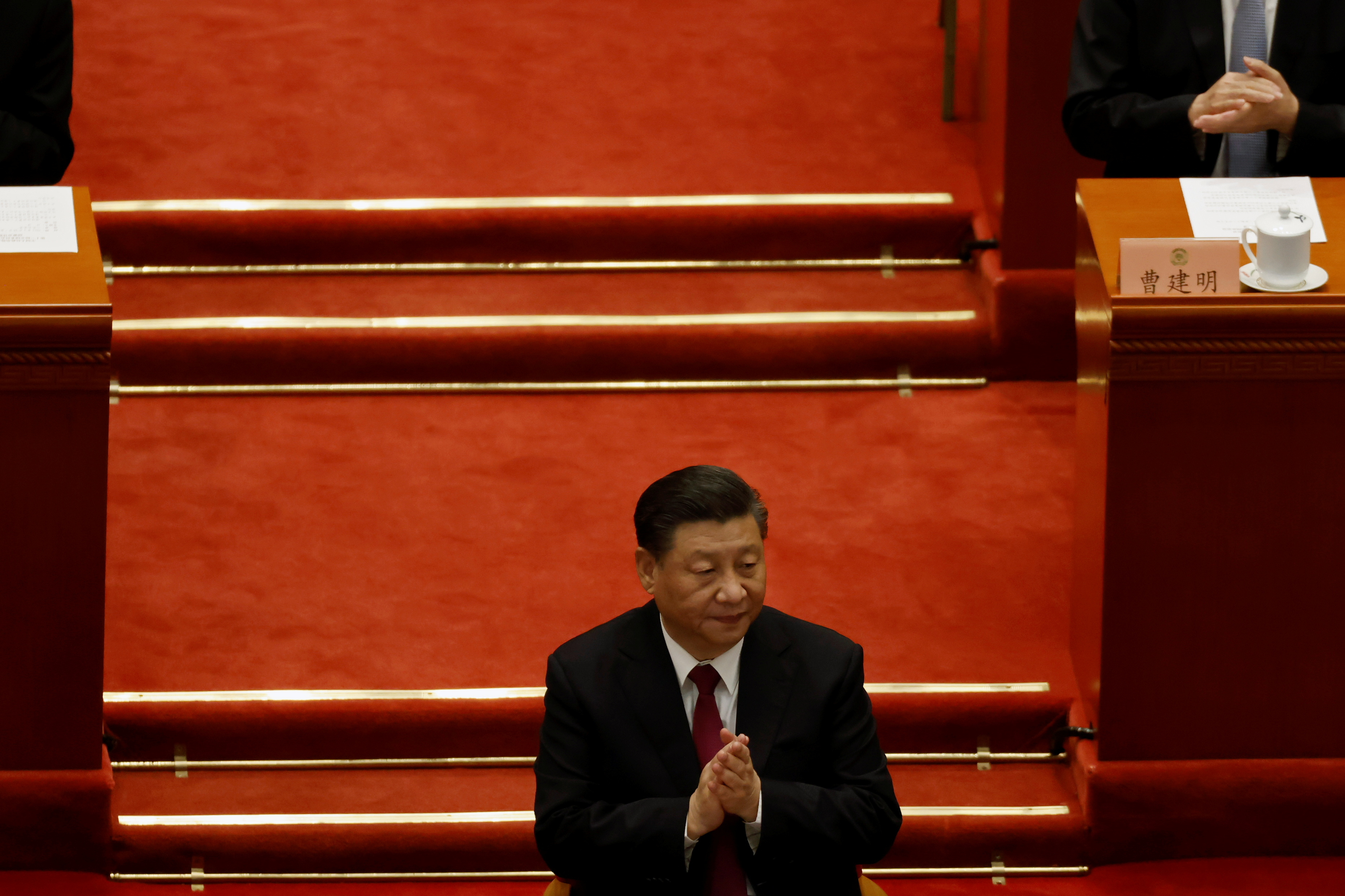 Chinese President Xi Jinping applauds at the closing session of the Chinese People's Political Consultative Conference (CPPCC) at the Great Hall of the People in Beijing, China March 10, 2021. REUTERS/Carlos Garcia Rawlins