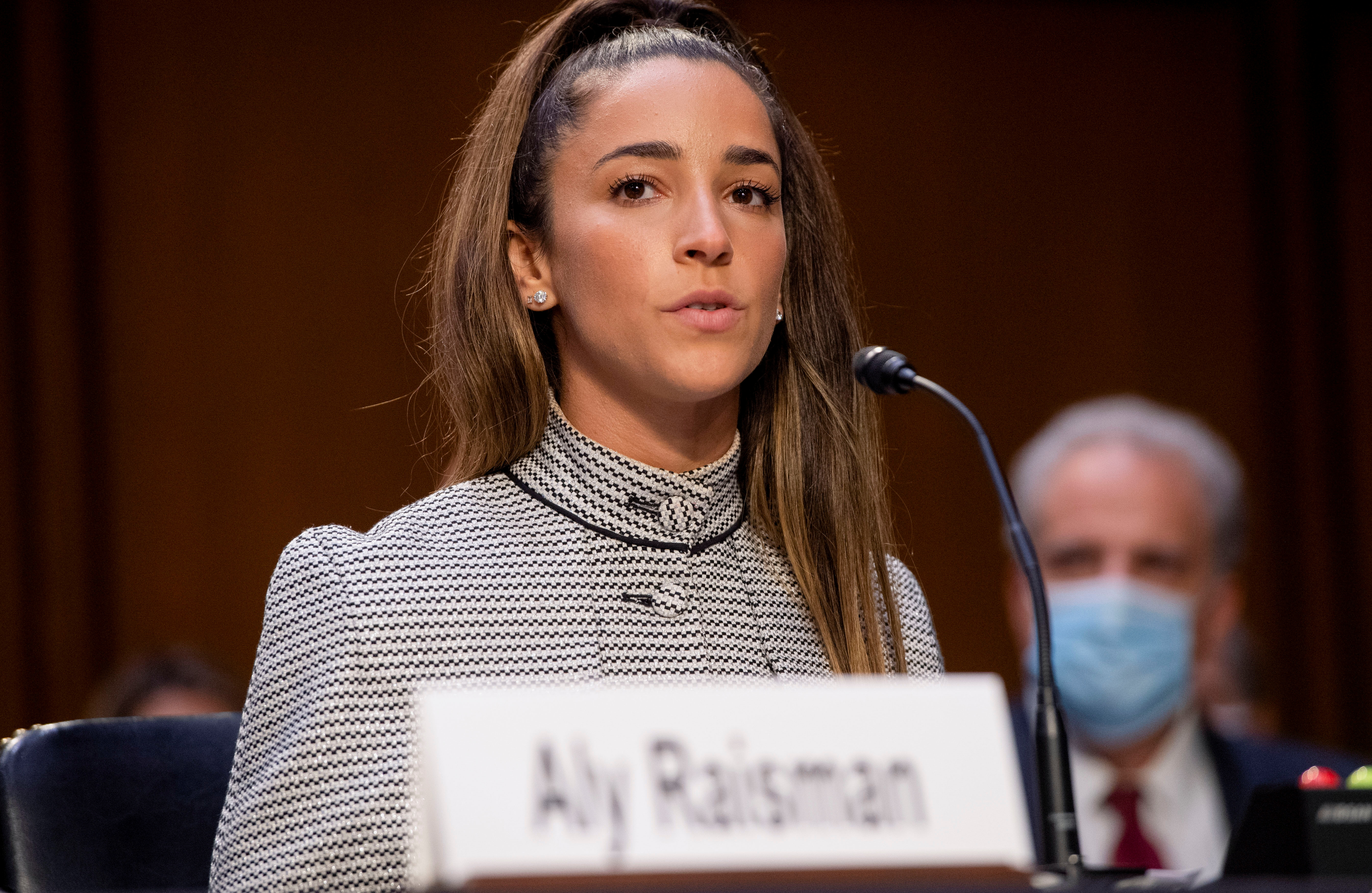 U.S. Olympic gymnast Aly Raisman testifies during a Senate Judiciary hearing about the Inspector General's report on the FBI handling of the Larry Nassar investigation of sexual abuse of Olympic gymnasts, on Capitol Hill, in Washington, D.C., U.S., September 15, 2021. Saul Loeb/Pool via REUTERS