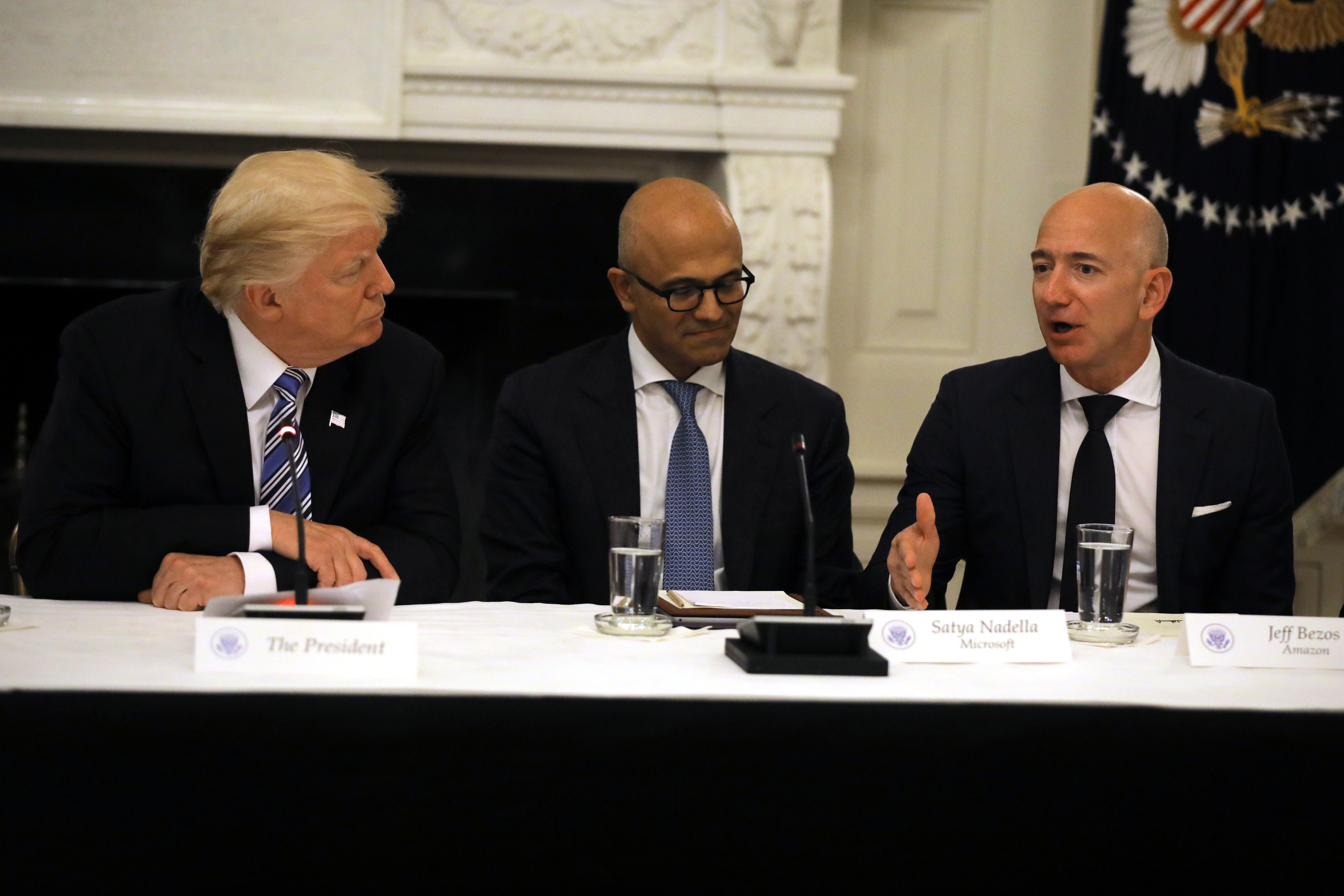 File photo: U.S. President Donald Trump and  Satya Nadella, CEO of Microsoft Corporation listen as Jeff Bezos, CEO of Amazon speaks during an American Technology Council roundtable at the White House in Washington, U.S., June 19, 2017. REUTERS/Carlos Barria
