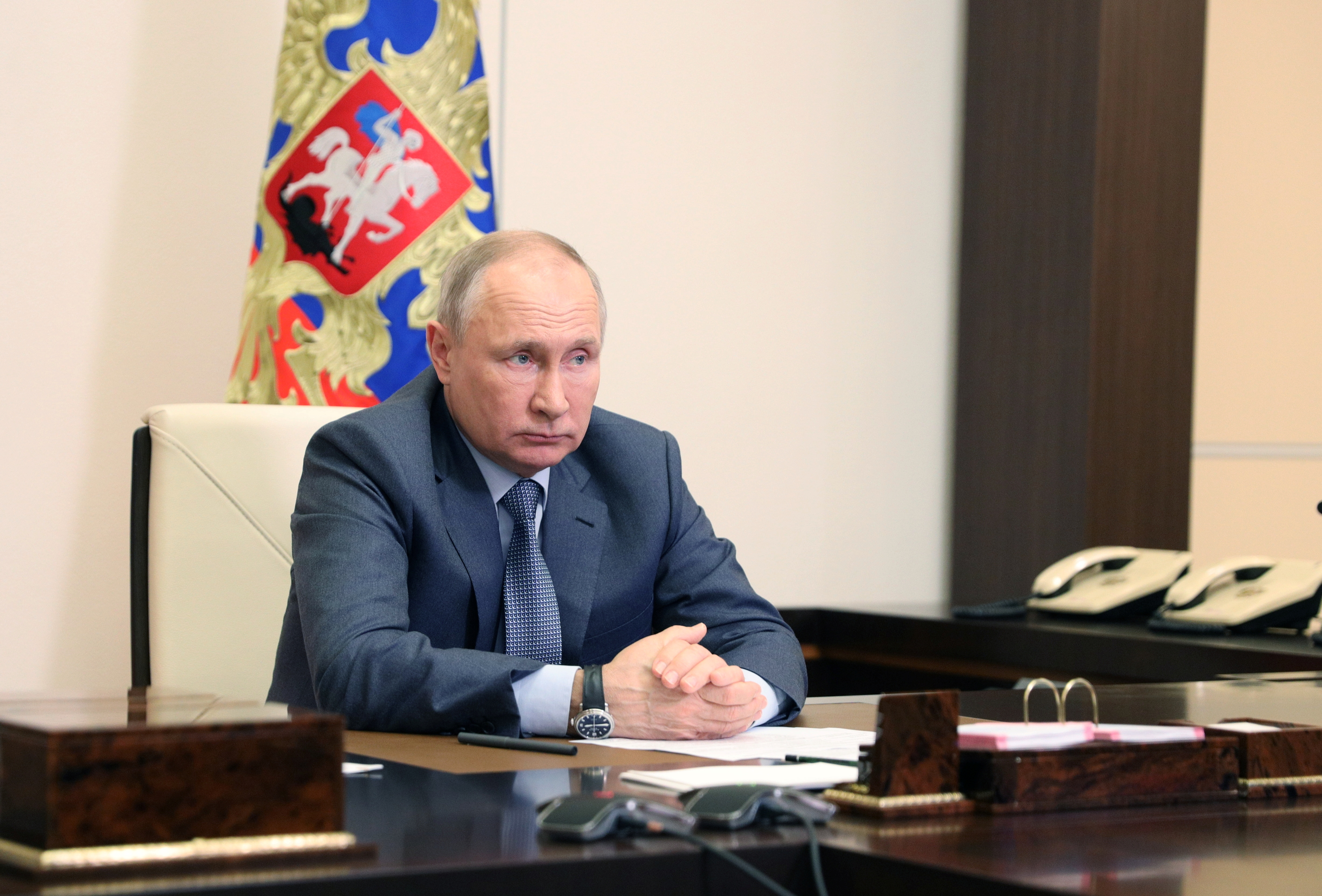 Russian President Vladimir Putin chairs a a video conference meeting with government members and officials outside Moscow, Russia May 13, 2021. Sputnik/Sergey Ilyin/Kremlin via REUTERS