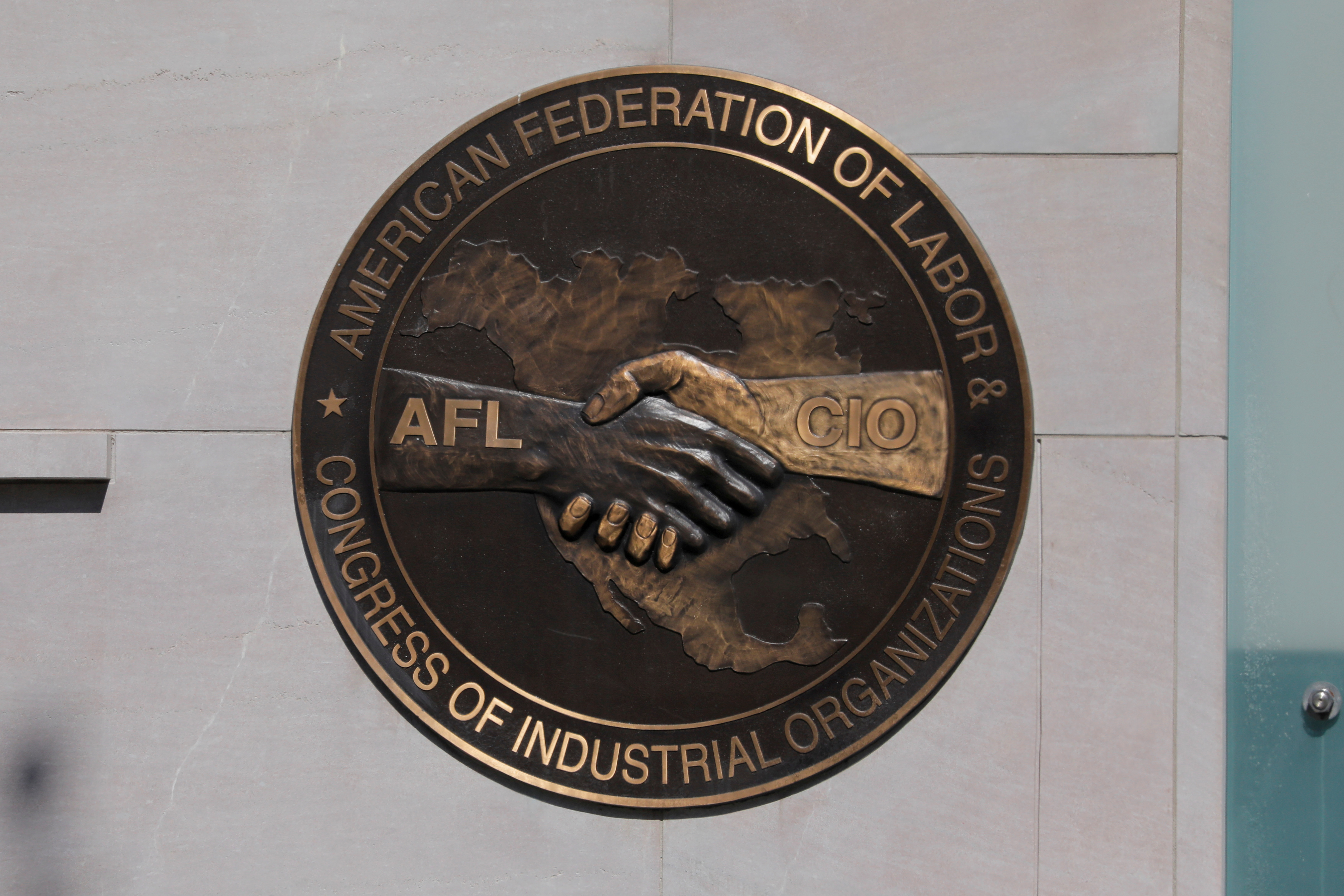 The patch of The American Federation of Labor and Congress of Industrial Organizations (AFL-CIO) is seen outside their headquarters in Washington, D.C., U.S., May 10, 2021. REUTERS/Andrew Kelly/File Photo