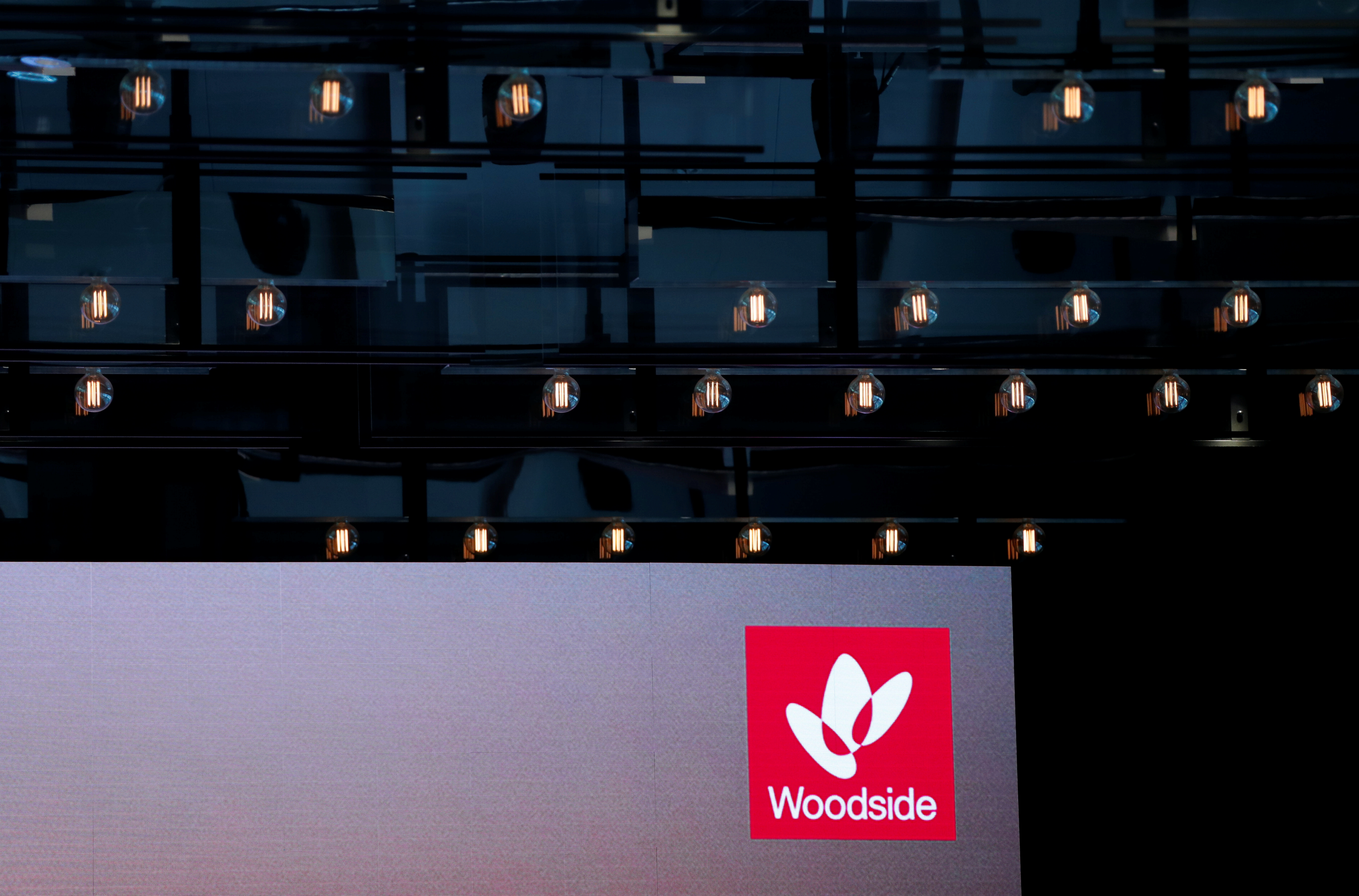 The logo for Woodside Petroleum, Australia's top independent oil and gas company, is projected onto a screen at a briefing for investors in Sydney, Australia, May 23, 2018.   REUTERS/David Gray