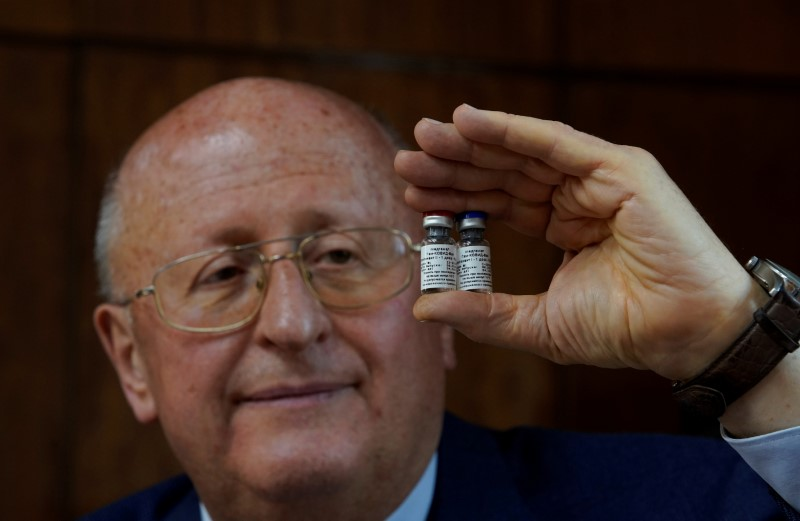 Alexander Gintsburg, director of the Gamaleya National Research Center for Epidemiology and Microbiology, shows bottles with Sputnik-V vaccine against the coronavirus disease (COVID-19) during an interview with Reuters in Moscow, Russia September 24, 2020. Picture taken September 24, 2020. REUTERS/Tatyana Makeyeva/File Photo