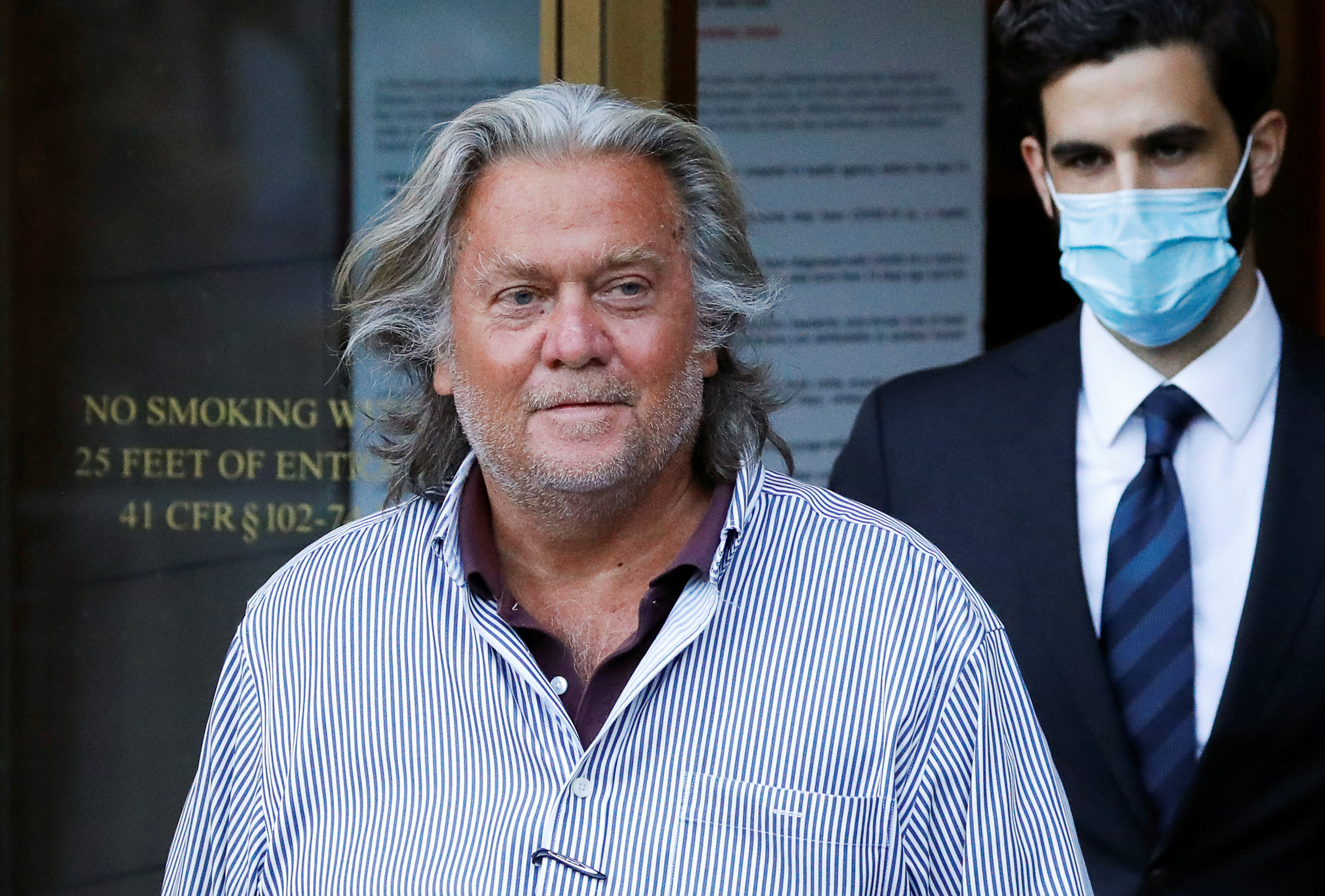 Former White House Chief Strategist Steve Bannon exits the Manhattan Federal Court, following his arraignment hearing for conspiracy to commit wire fraud and conspiracy to commit money laundering, in the Manhattan borough of New York City, New York, U.S. August 20, 2020. REUTERS/Andrew Kelly