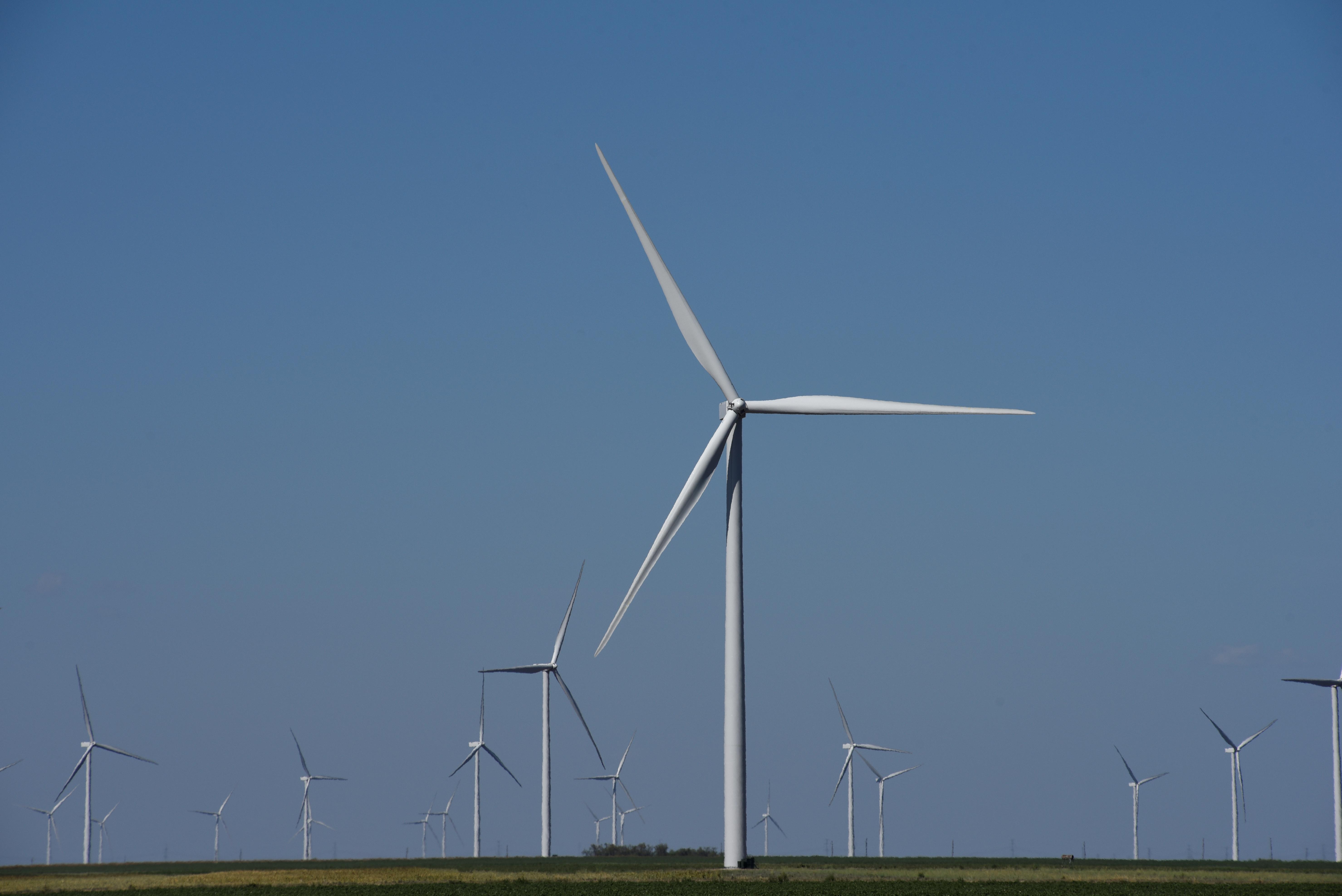 Wind turbines generate power on a farm near Throckmorton, Texas U.S. August 24, 2018. REUTERS/Nick Oxford