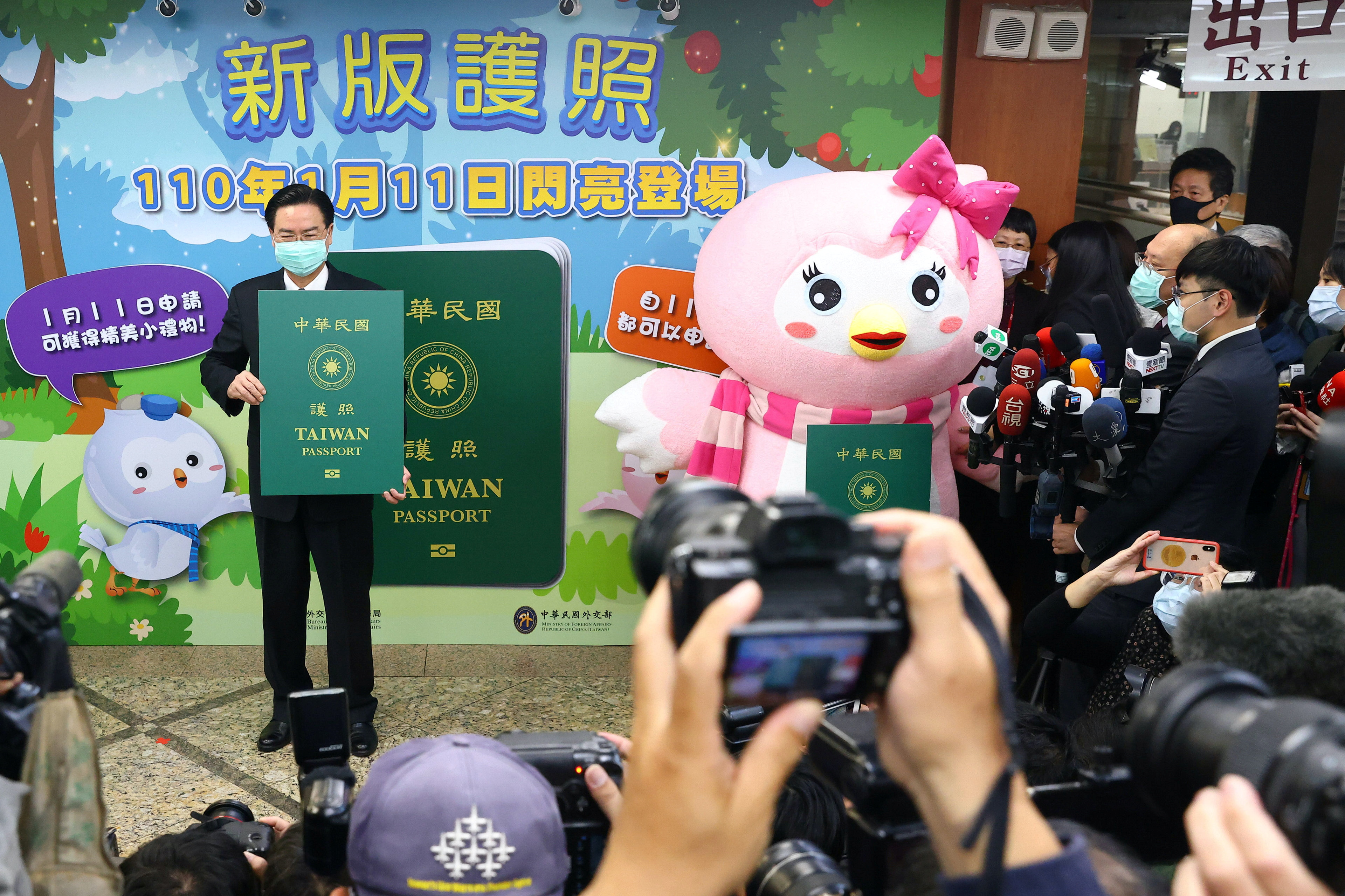 Taiwan's Foreign Minister Joseph Wu takes photos with a sample of the new Taiwan passport in Taipei, Taiwan, January 11, 2021. REUTERS/Ann Wang