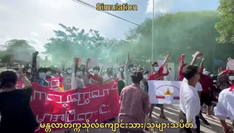 Anti-coup protesters march on the anniversary of a 1988 uprising, in Mandalay, Myanmar August 8, 2021 in this still image obtained by Reuters from a video