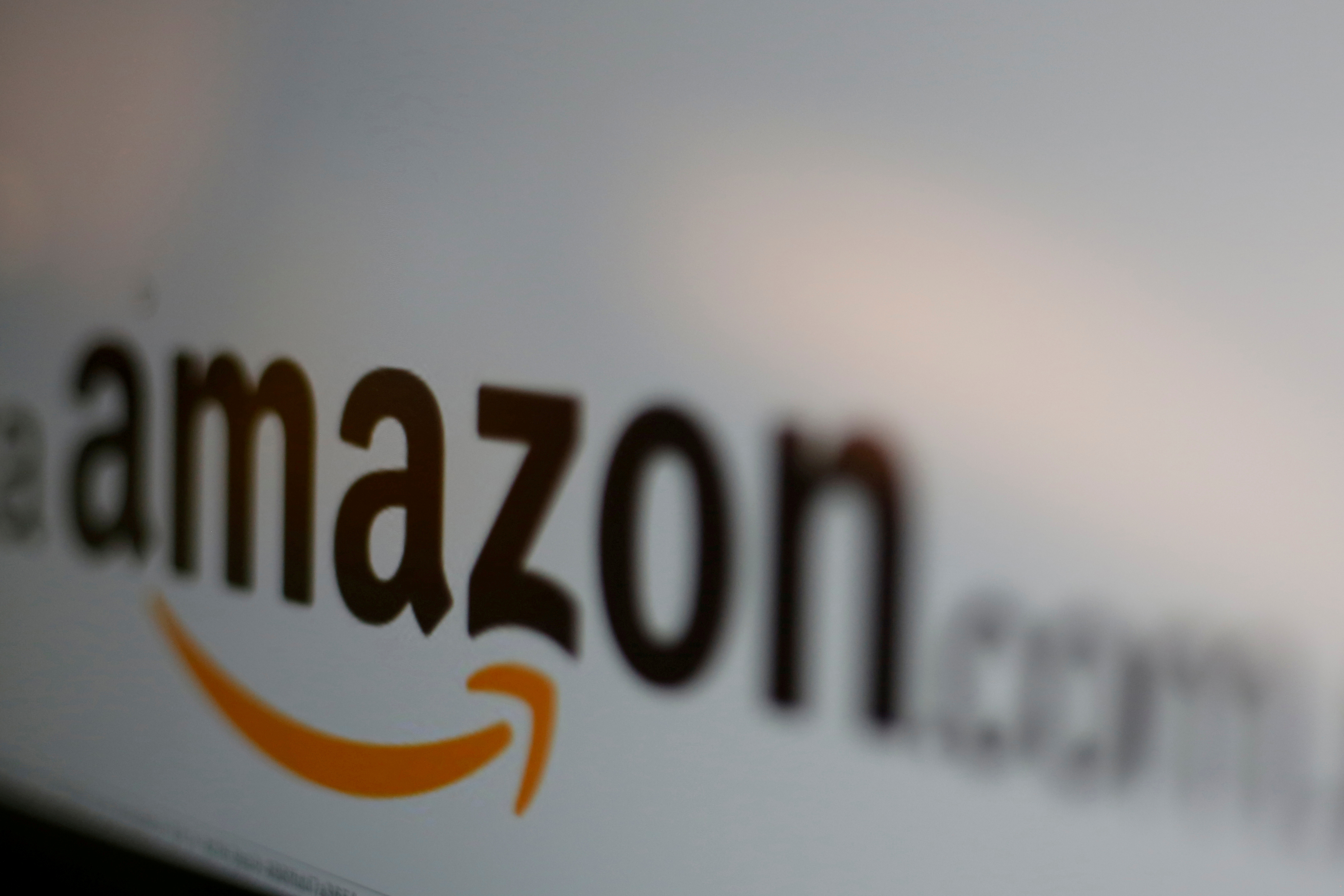 The logo of the web service Amazon is pictured in this June 8, 2017 illustration photo. REUTERS/Carlos Jasso/Illustration