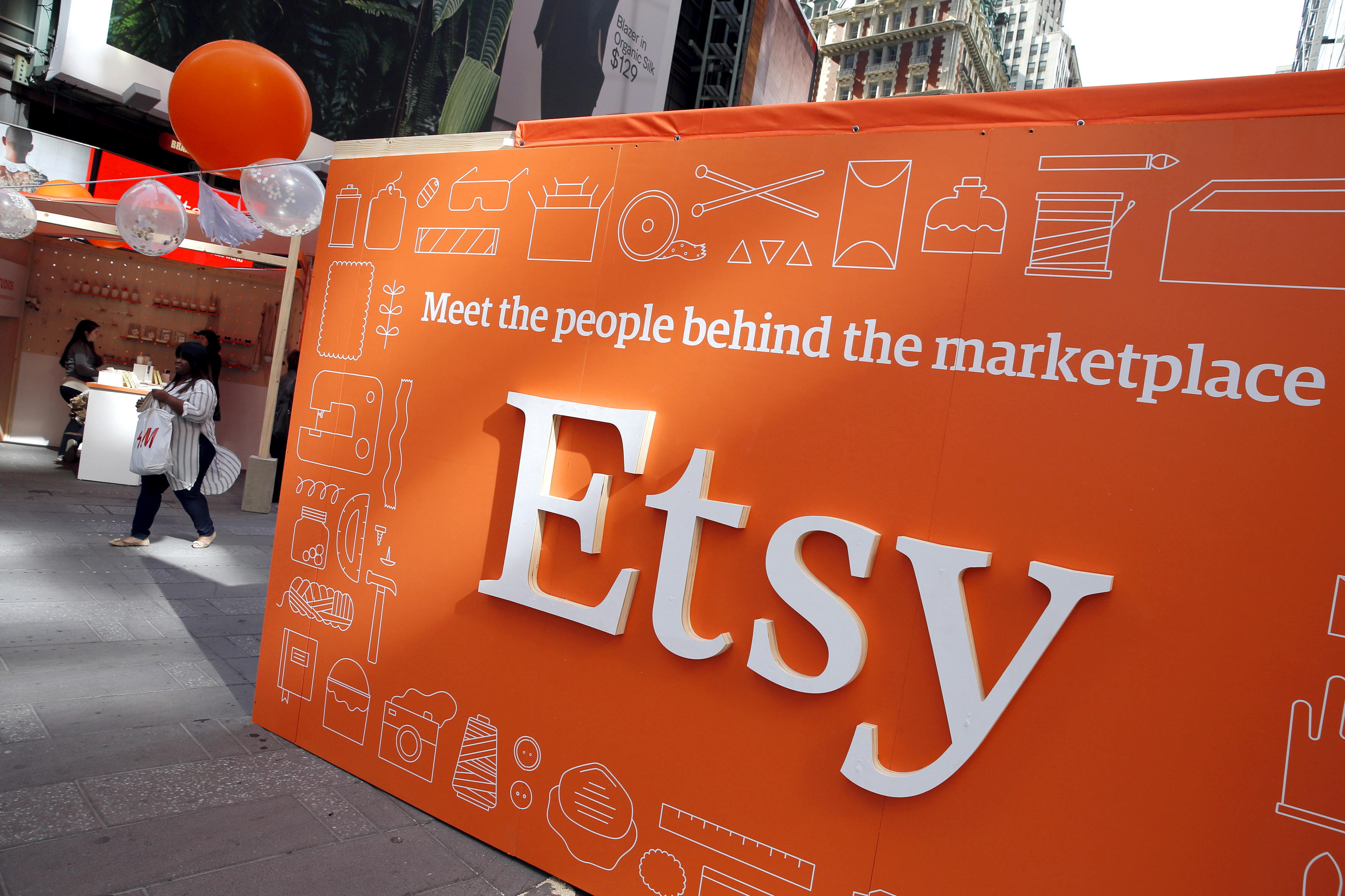 A sign advertising the online seller Etsy Inc. is seen outside the Nasdaq market site in Times Square in New York April 16, 2015.   REUTERS/Mike Segar/File Photo