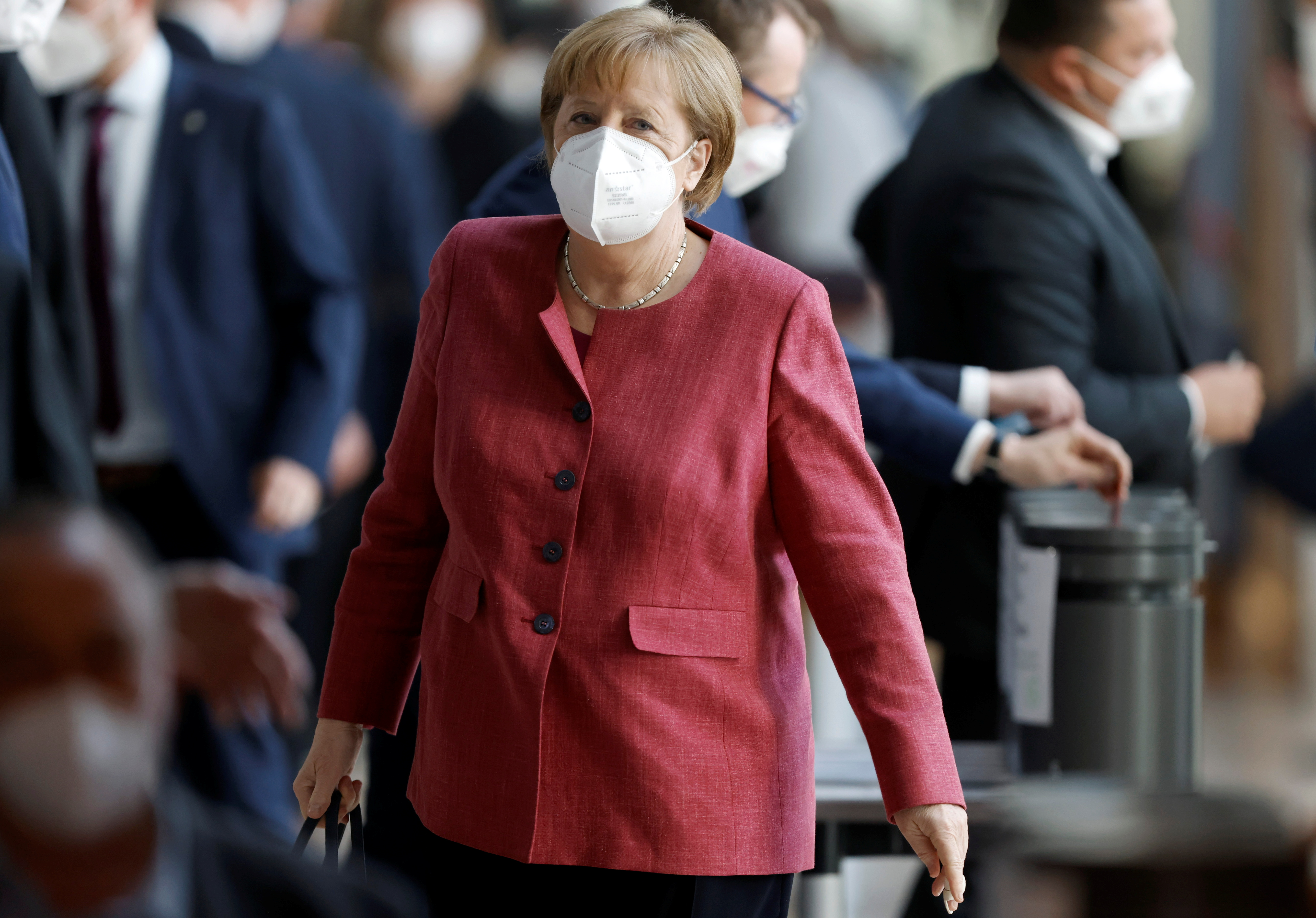 German Chancellor Angela Merkel leaves after voting for COVID-19 regulations following a debate about the Infection Protection Act in the lower house of parliament Bundestag in Berlin, Germany April 21, 2021.    REUTERS/Axel Schmidt
