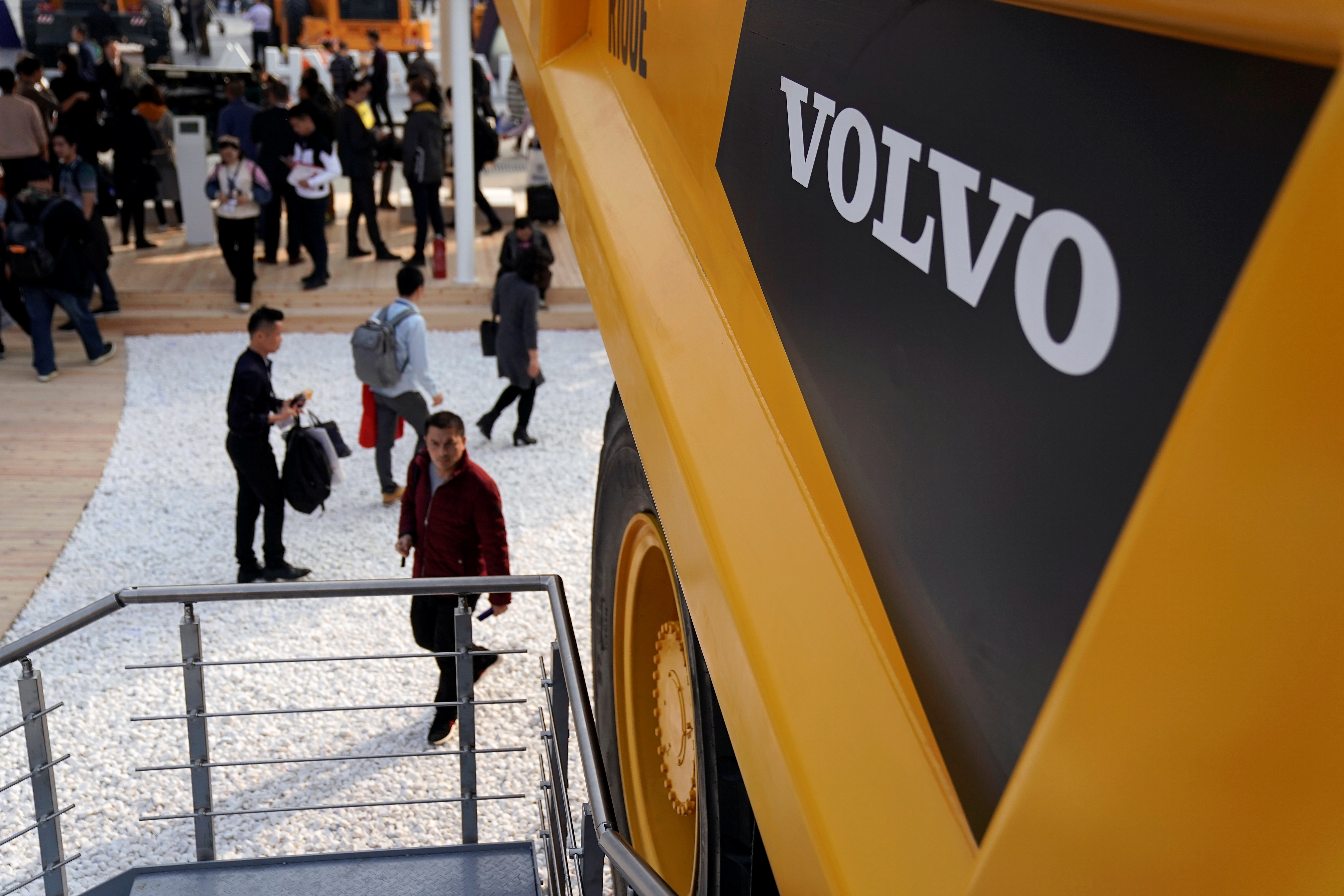People visit heavy machinery of Volvo at Bauma China, the International Trade Fair for Construction Machinery in Shanghai, China November 27, 2018. REUTERS/Aly Song/Files