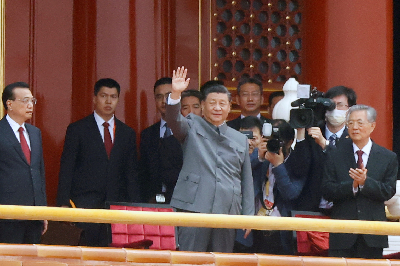 Chinese President Xi Jinping waves next to Premier Li Keqiang and former president Hu Jintao at the end of the event marking the 100th founding anniversary of the Communist Party of China, on Tiananmen Square in Beijing, China July 1, 2021. REUTERS/Carlos Garcia Rawlins
