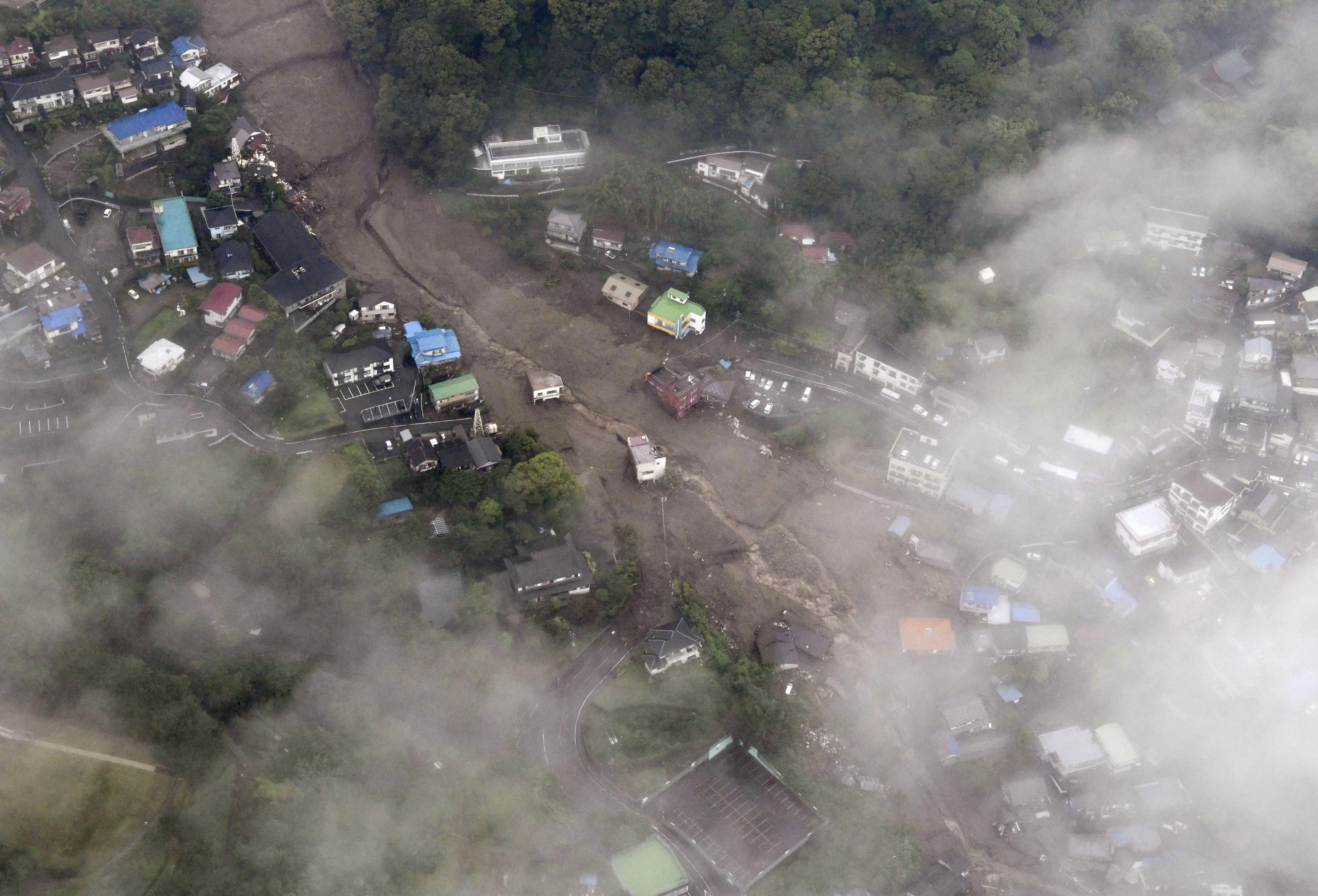 An aerial view shows the site of a mudslide caused by heavy rain at Izusan district in Atami, Japan July 3, 2021. Kyodo/via REUTERS