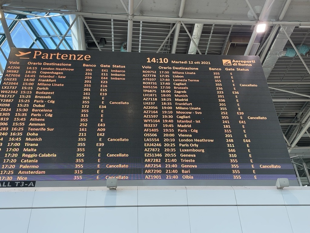 A departure board shows cancelled Alitalia flights at Rome–Fiumicino International Airport on Oct. 12, 2021. REUTERS/Rob Cox