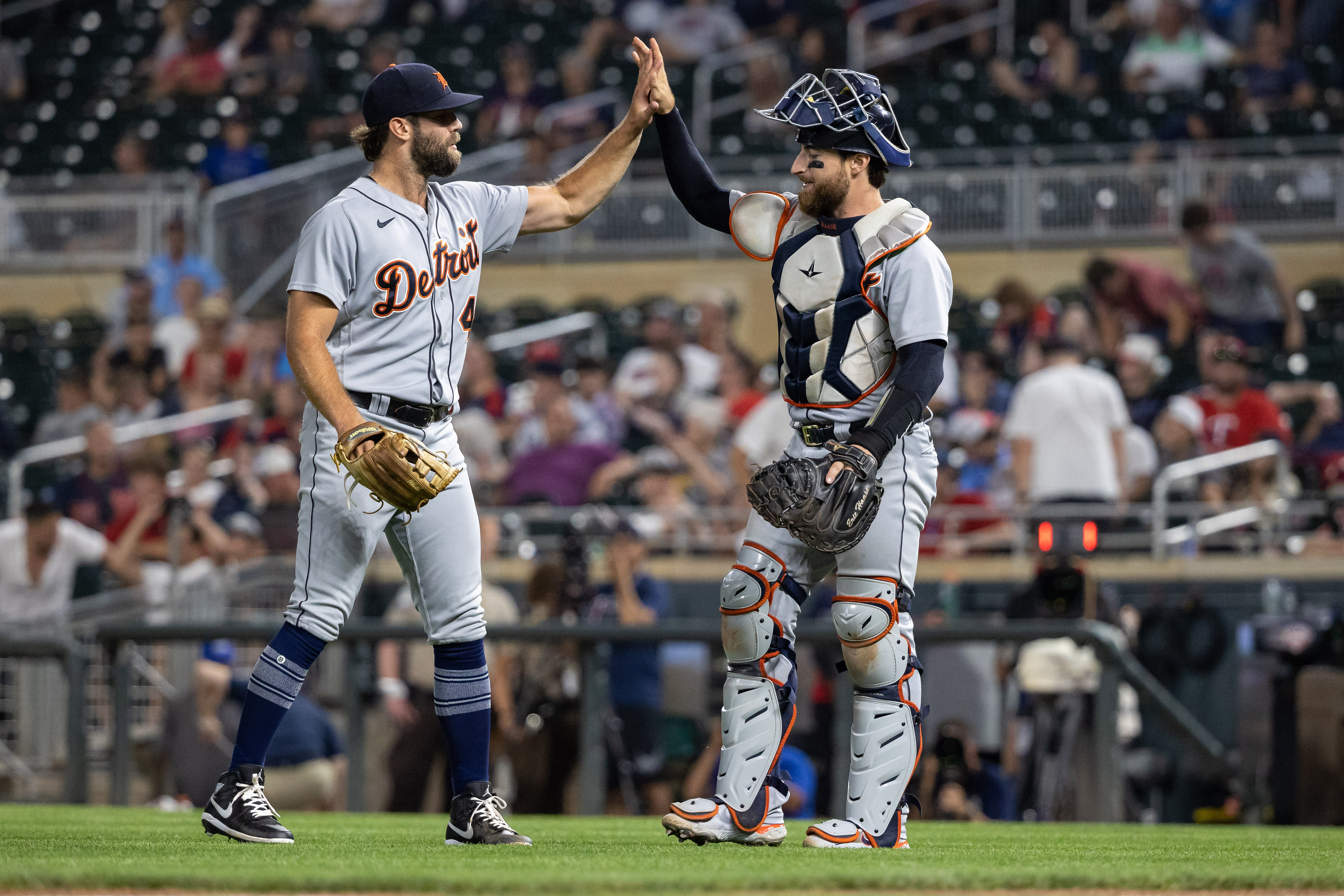 Jul 27, 2021; Minneapolis, Minnesota, USA; Detroit Tigers relief pitcher Daniel Norris (44) and catcher Eric Haase (13) celebrate after defeating the Minnesota Twins at Target Field. Jordan Johnson-USA TODAY Sports