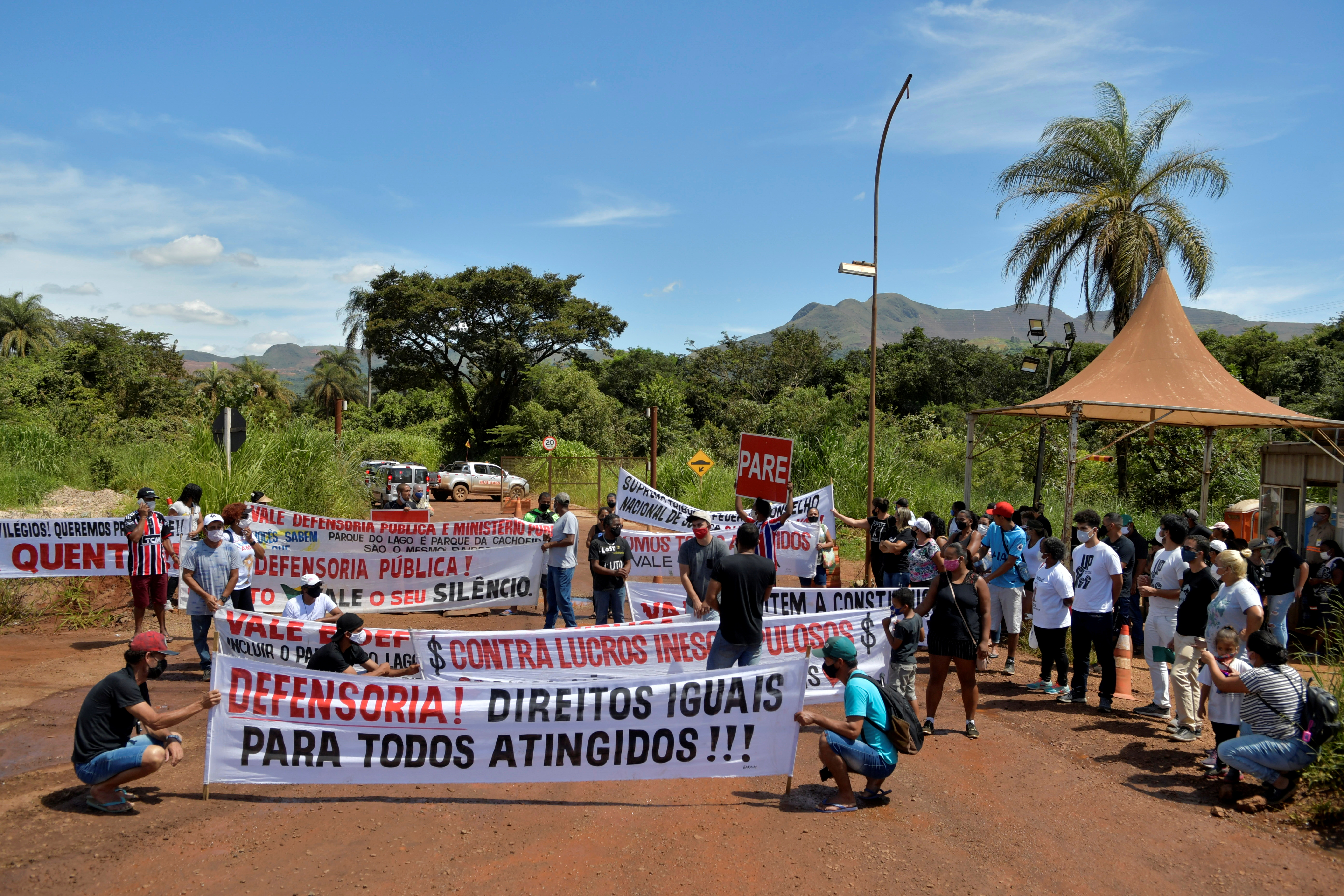 People affected by the disaster of the tailings dam owned by Brazilian mining company Vale SA, protest in front of the company, two years after it collapsed in Brumadinho, Minas Gerais state, Brazil, January 25, 2021. The banner reads: