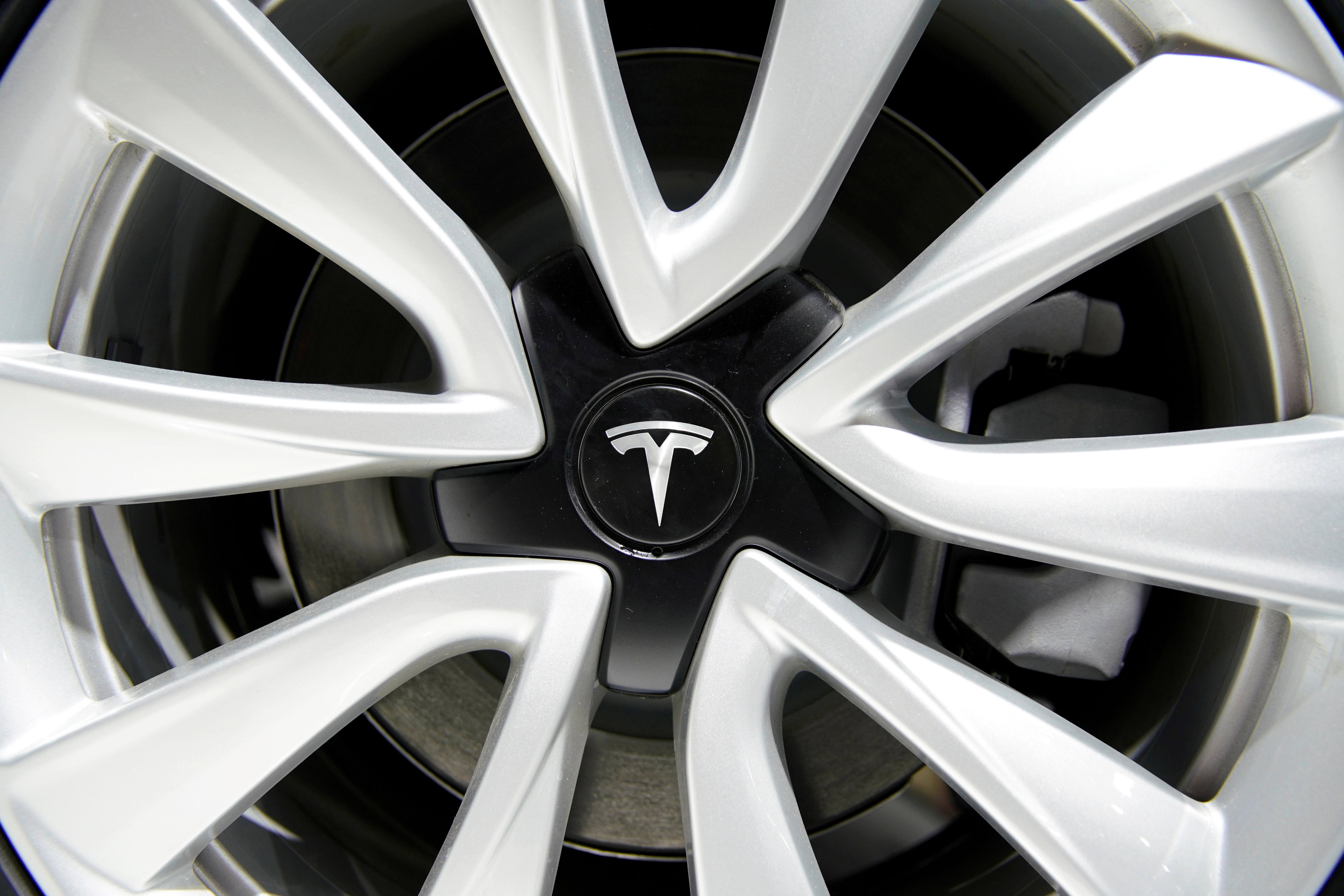 A Tesla logo is seen on a wheel rim during the media day for the Shanghai auto show in Shanghai, China April 16, 2019. REUTERS/Aly Song