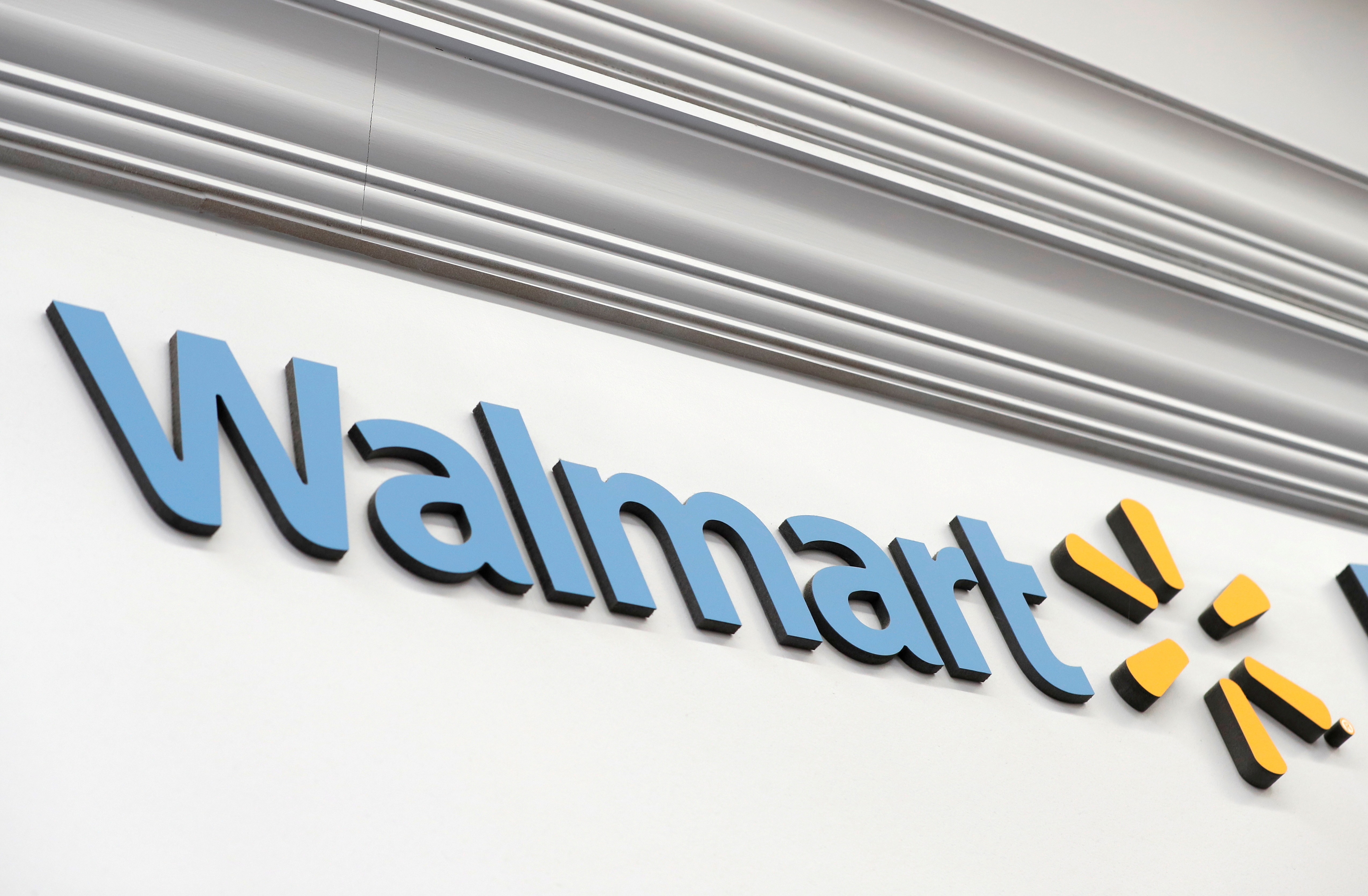 A Walmart sign is seen inside its department store in West Haven, Connecticut, U.S., February 17, 2021. REUTERS/Mike Segar