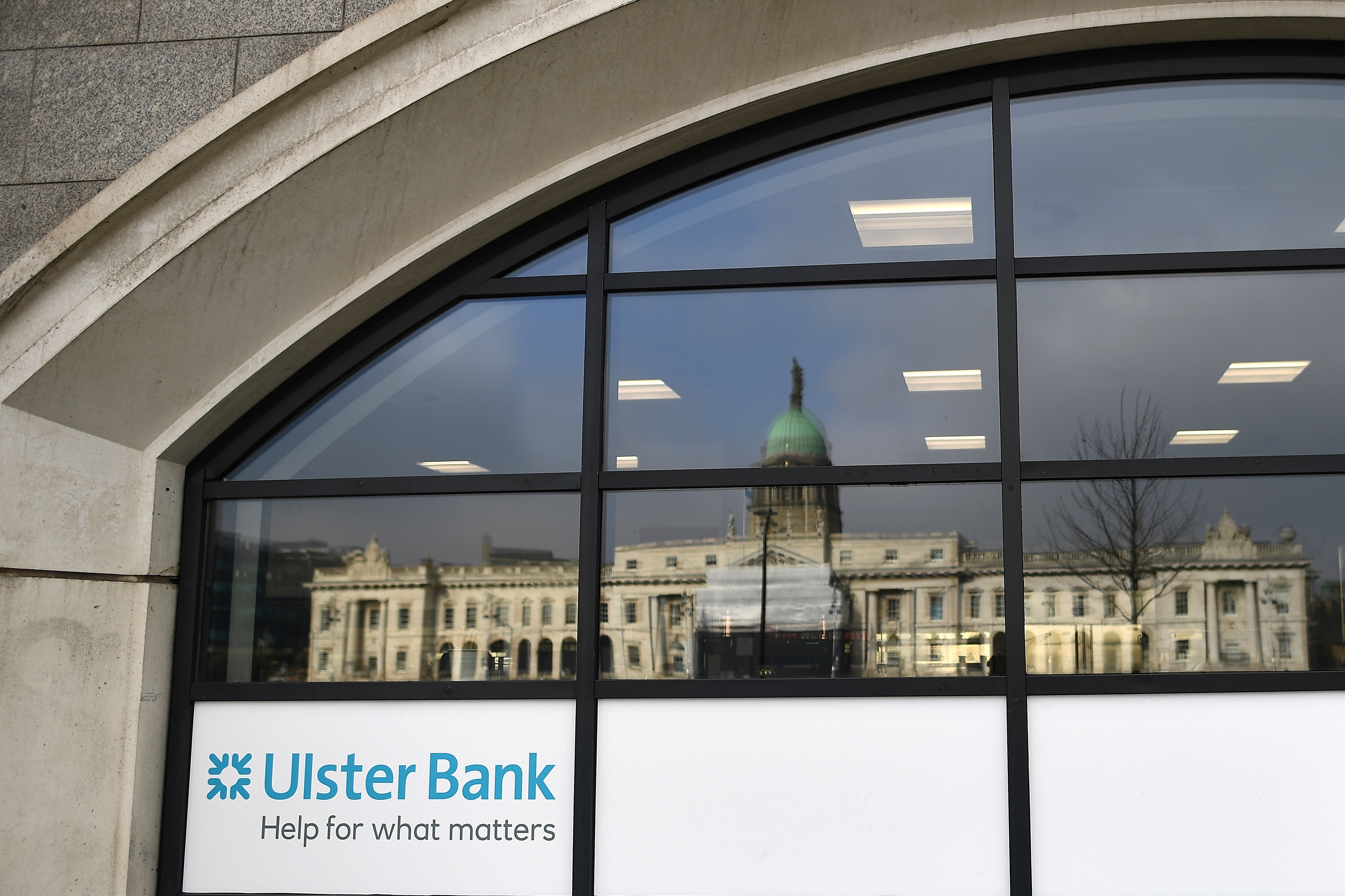 The Customs House is reflected in the window of the Ulster Bank, in Dublin, Ireland, March 1, 2021. REUTERS/Clodagh Kilcoyne