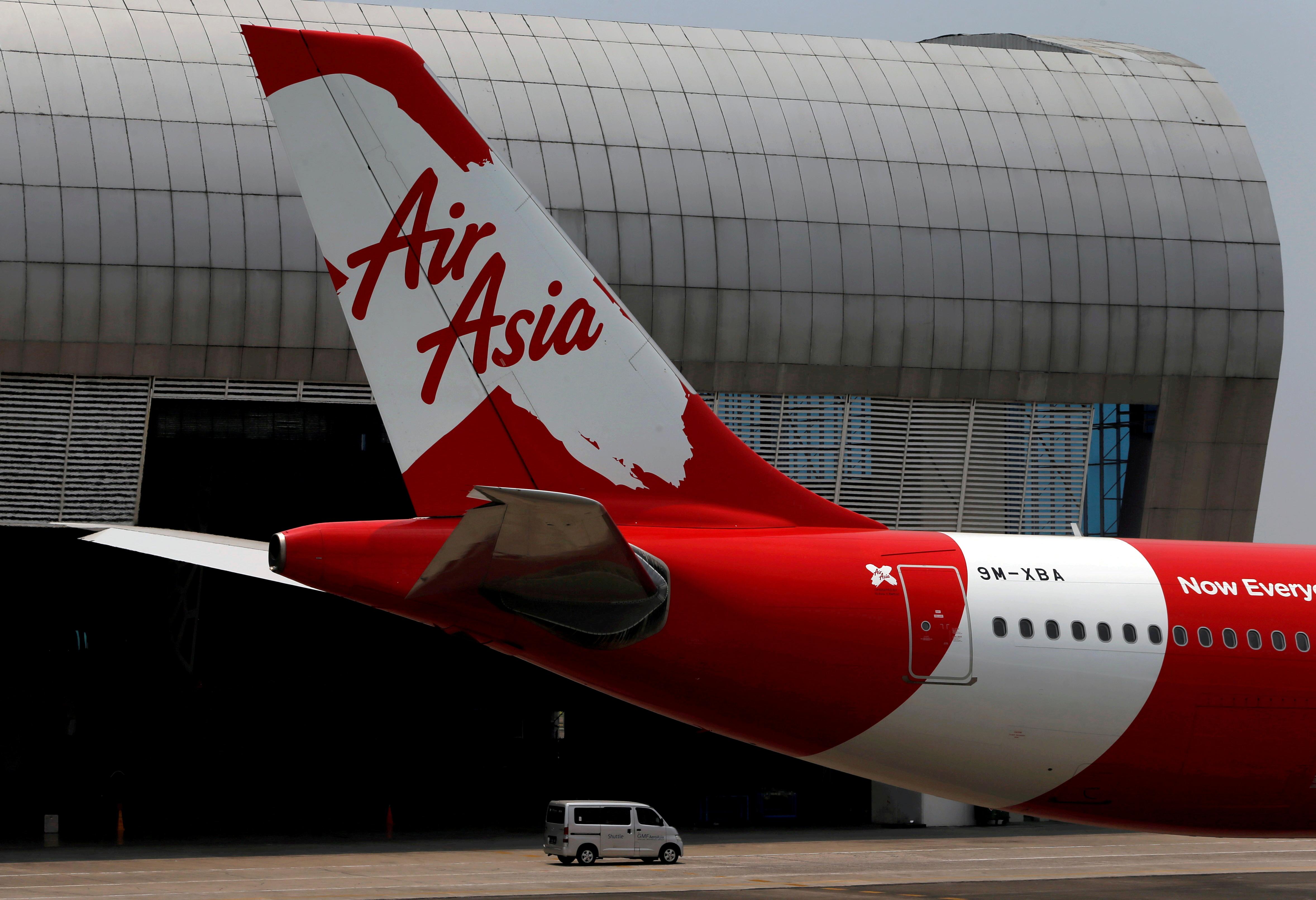 Tail of AirAsia X plane as seen at the Garuda Maintenance Facility AeroAsia in Tangerang, Indonesia, September 20, 2017.  REUTERS/Beawiharta