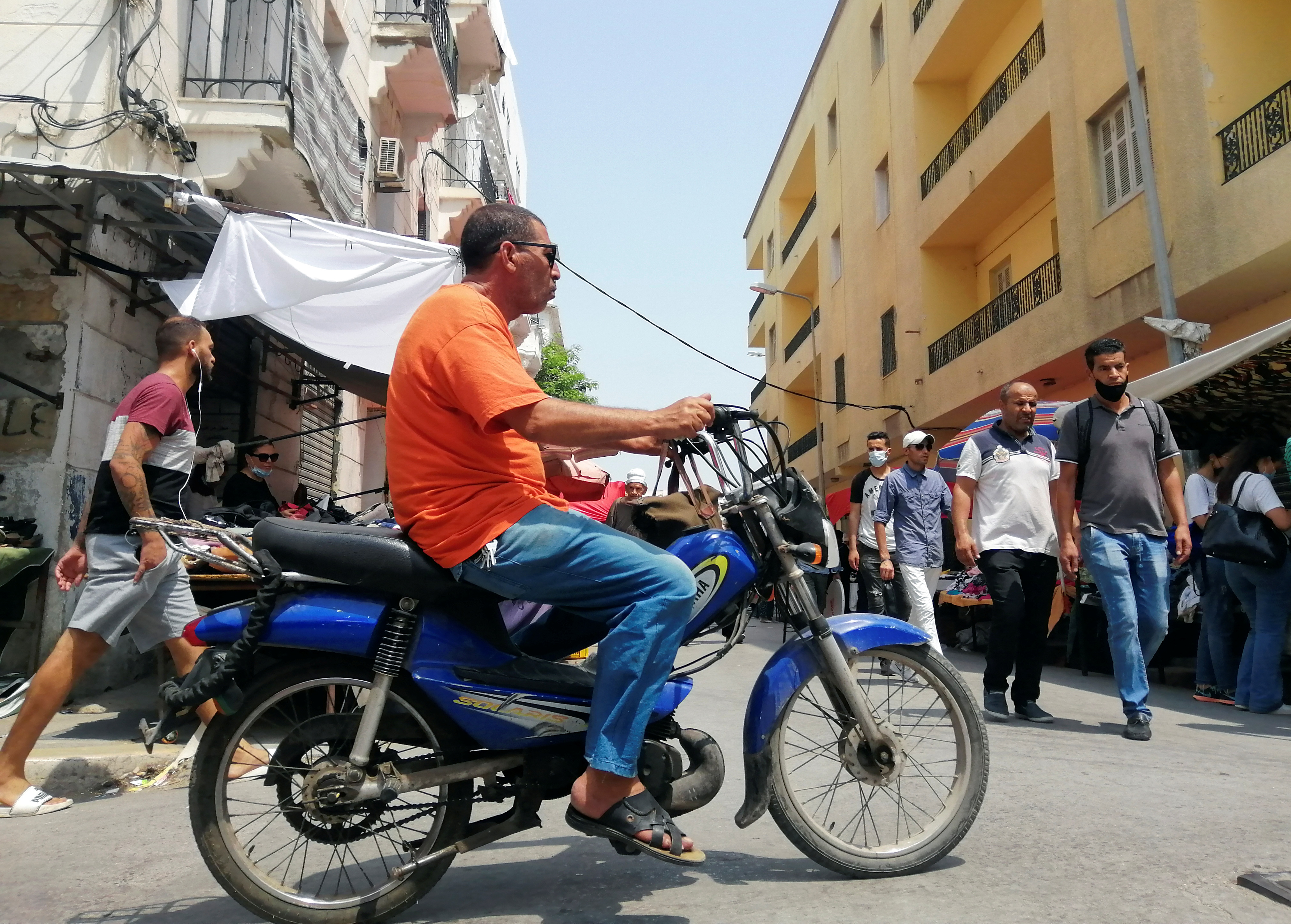 A man rides a motorbike in Tunis, Tunisia August 12, 2021.  REUTERS/Jihed Abidellaoui