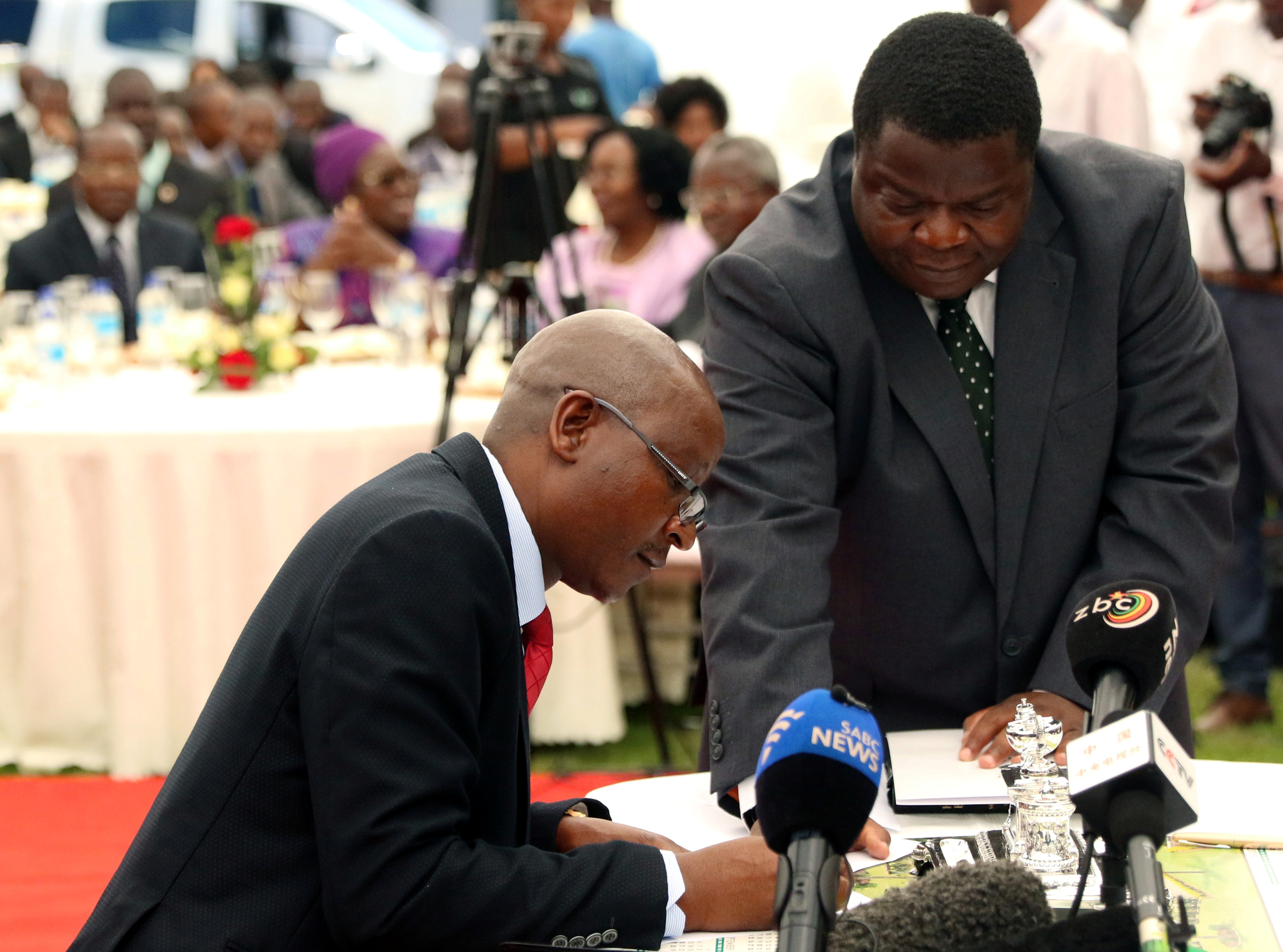 Zimbabwean Minister of Justice Ziyambi Ziyambi signs the oath of office during the swearing in ceremony at State House in Harare, Zimbabwe, on December 4, 2017.  REUTERS/Philimon Bulawayo
