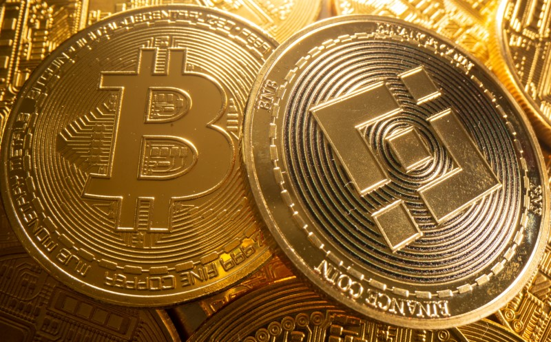 A representations of cryptocurrency Bitcoin and Binance is seen in this illustration taken August 6, 2021. REUTERS/Dado Ruvic/Illustration