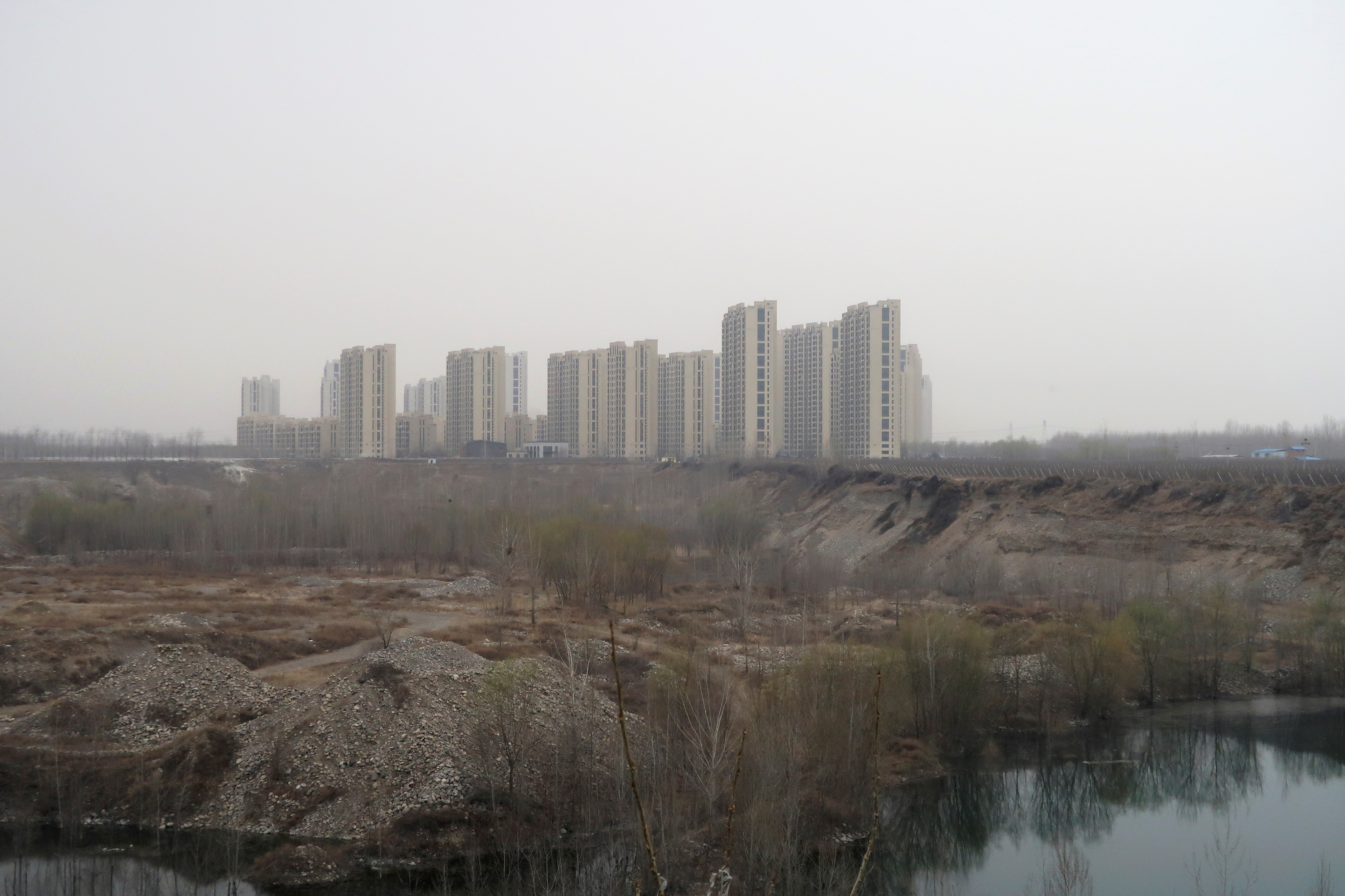 The Taoyuan Xindu Kongquecheng apartment compound developed by China Fortune Land Development is seen in Zhuozhou, Hebei province, China March 19, 2021. Picture taken March 19, 2021. REUTERS/Lusha Zhang