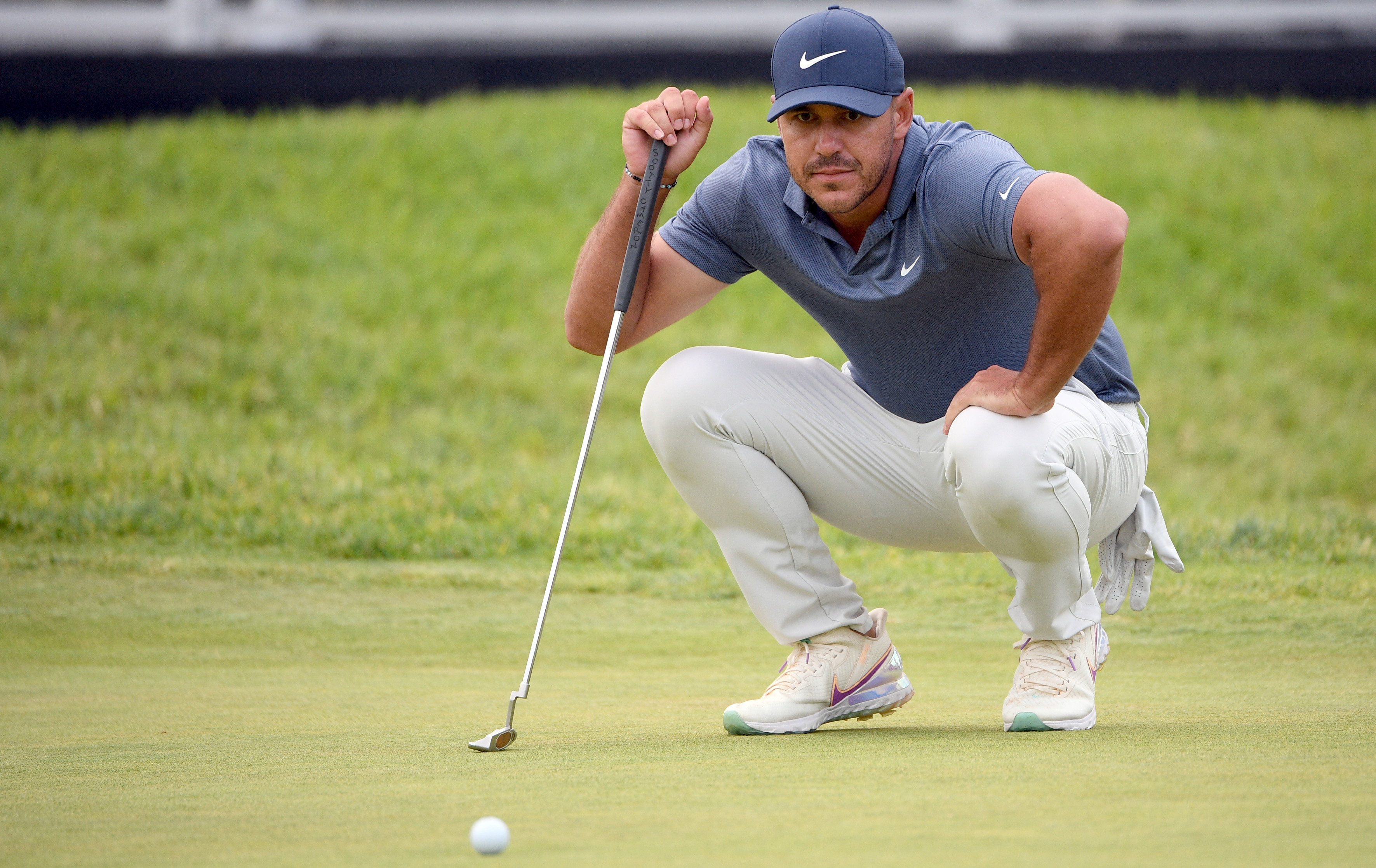 Jun 18, 2021; San Diego, California, USA; Brooks Koepka lines up a putt on the 18th green during the second round of the U.S. Open golf tournament at Torrey Pines Golf Course. Mandatory Credit: Orlando Ramirez-USA TODAY Sports