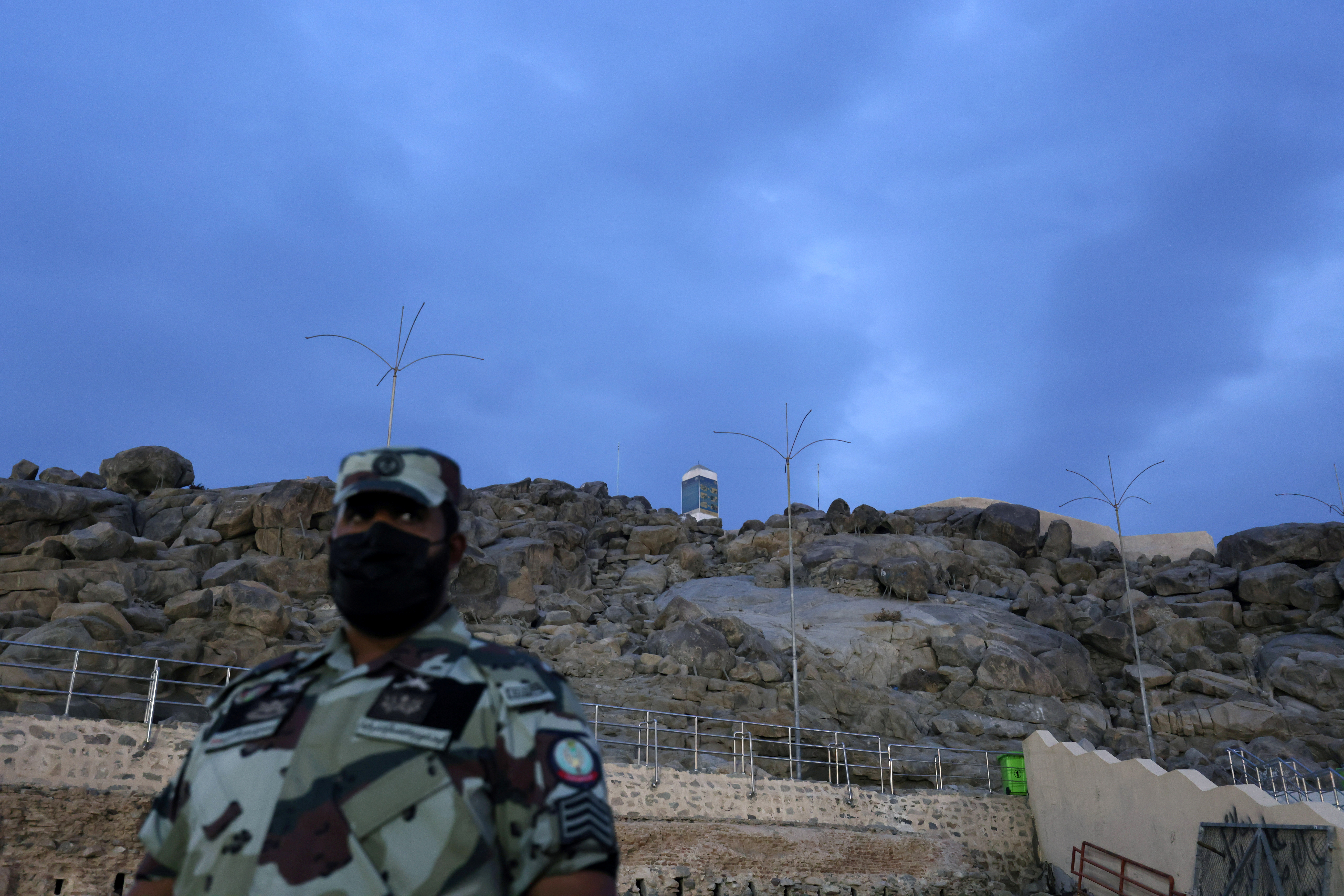The Mount of Mercy is pictured as a member of Saudi security forces stands guard at the plain of Arafat where Muslims gather during the annual Haj pilgrimage, outside the holy city of Mecca, Saudi Arabia July 19, 2021. REUTERS/Ahmed Yosri