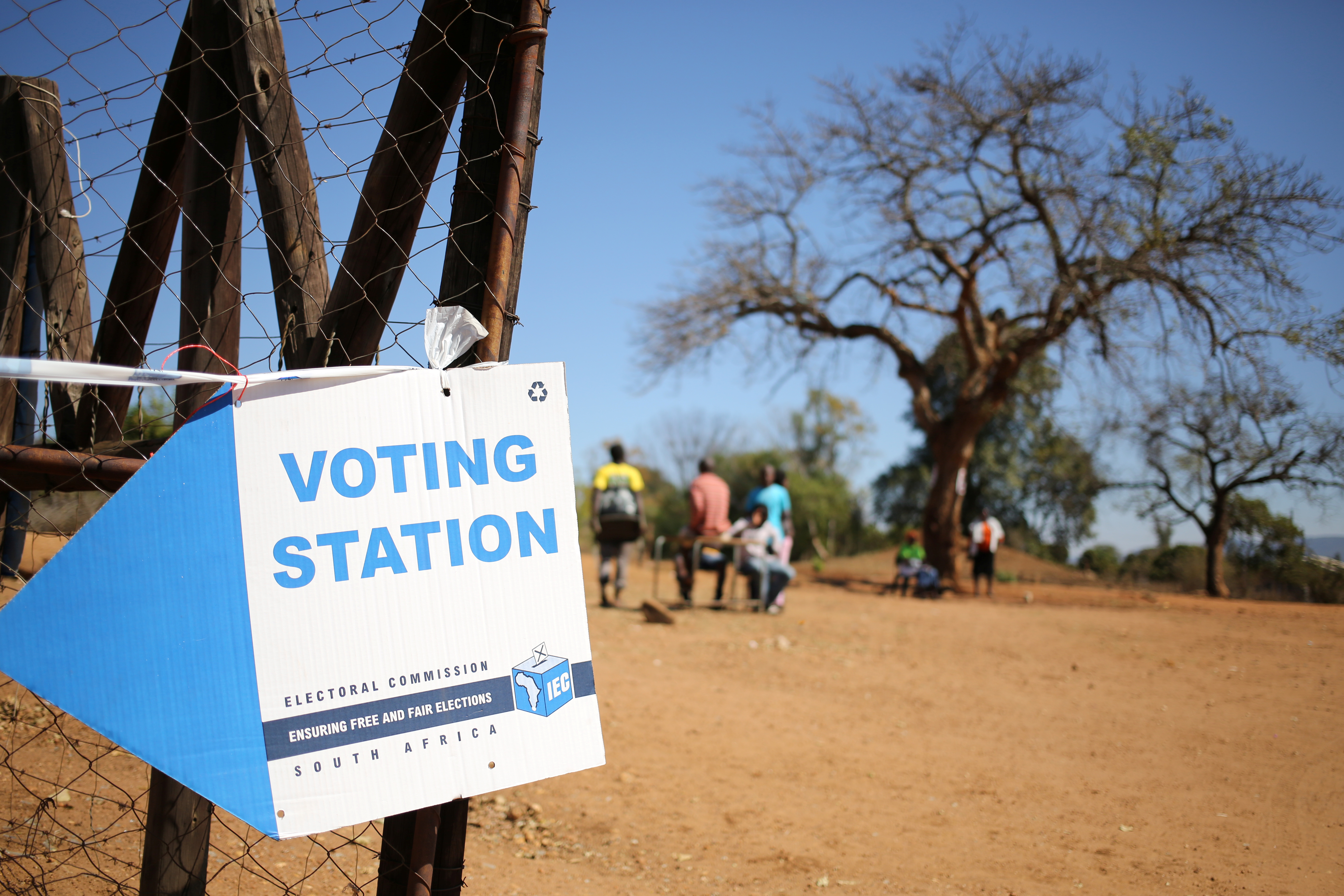 Locals are seen outside a polling station during tense local munincipal elections in Vuwani, South Africa's northern Limpopo province, August 3, 2016. REUTERS/Siphiwe Sibeko