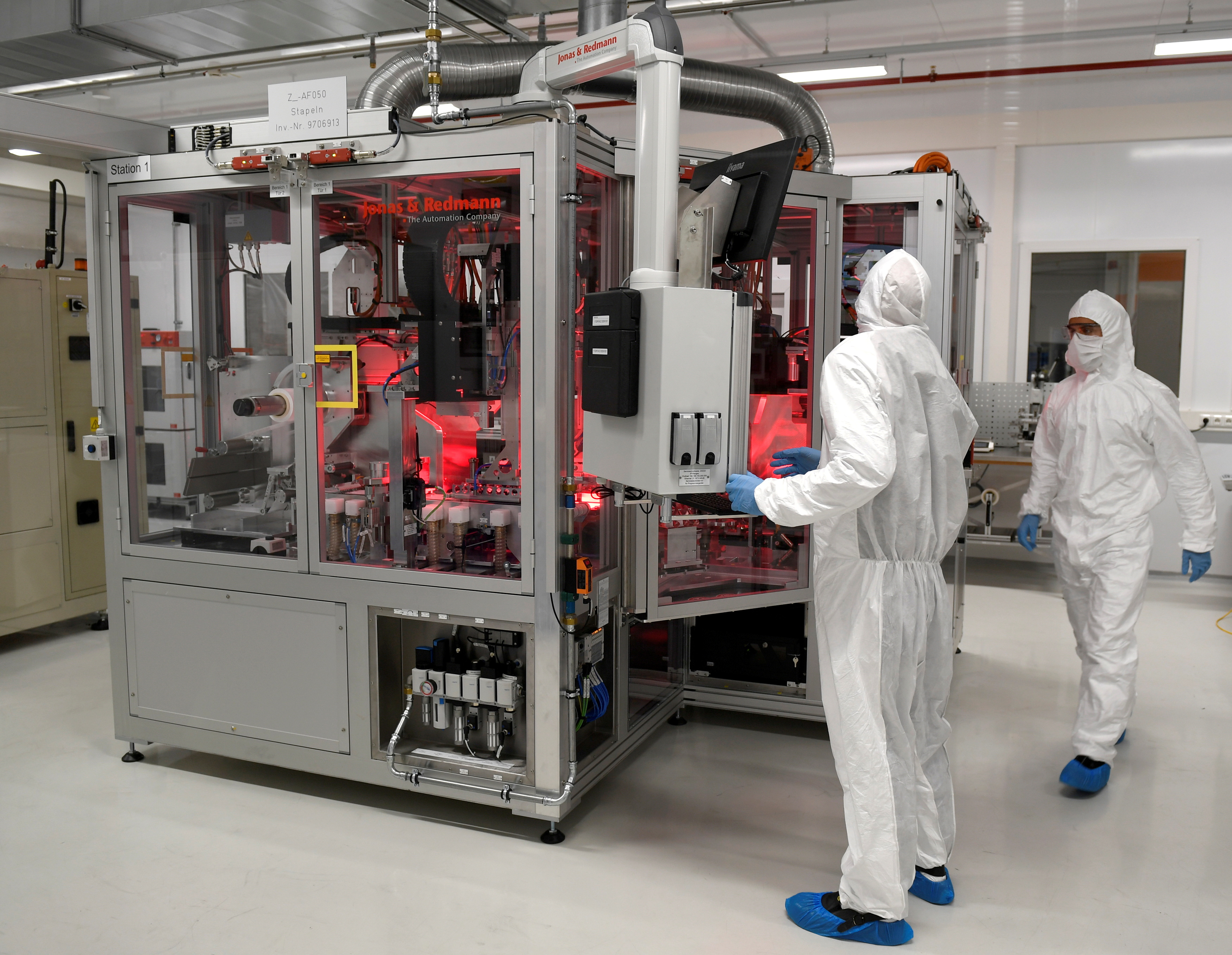 Employees of German carmaker Volkswagen work in a production line of VW' new battery plant in Salzgitter, Germany September 23, 2019. REUTERS/Fabian Bimmer