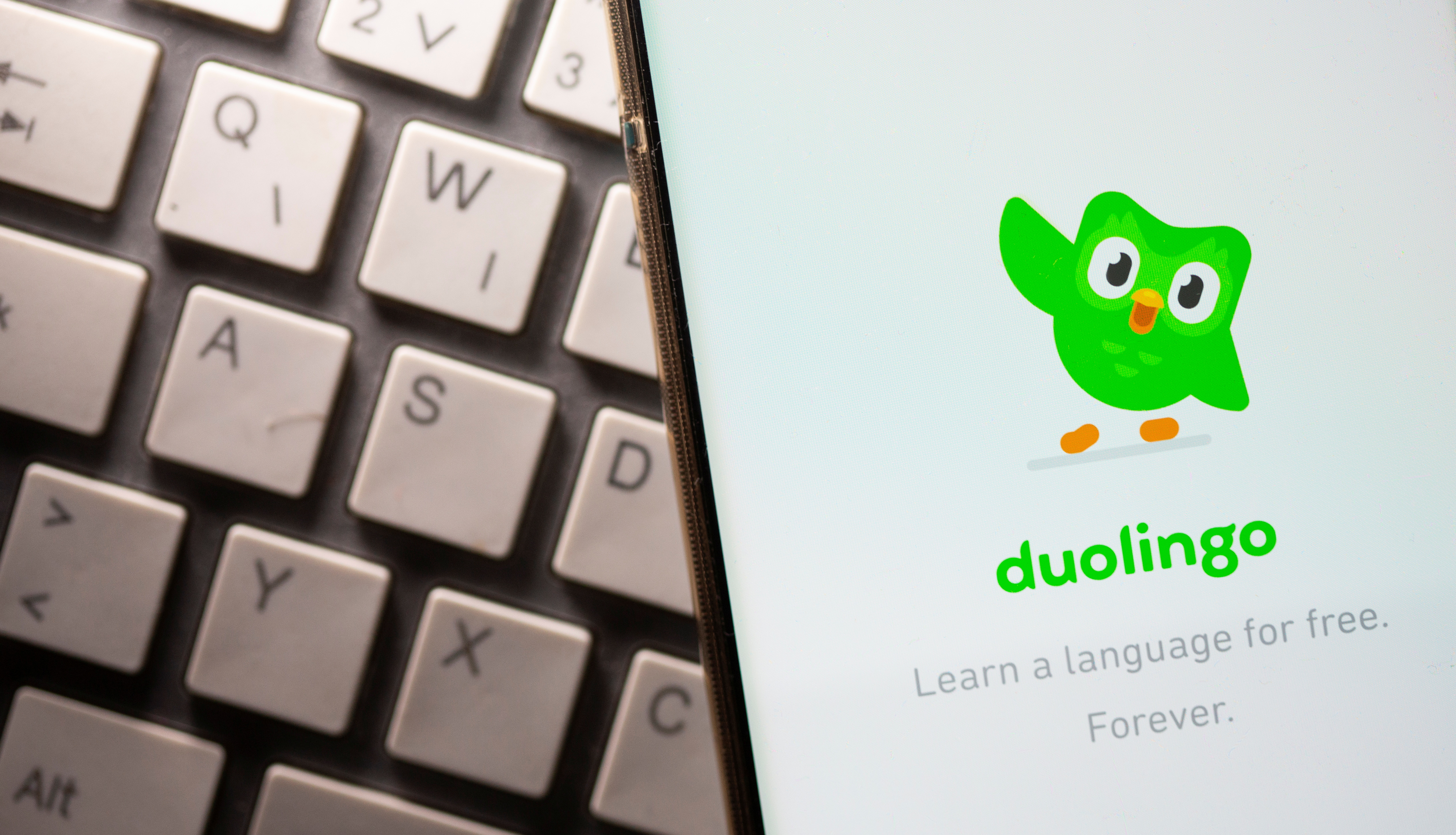 Smartphone with displayed Duolingo app is placed on the keyboard in this illustration taken, June 29, 2021. REUTERS/Dado Ruvic/Illustration