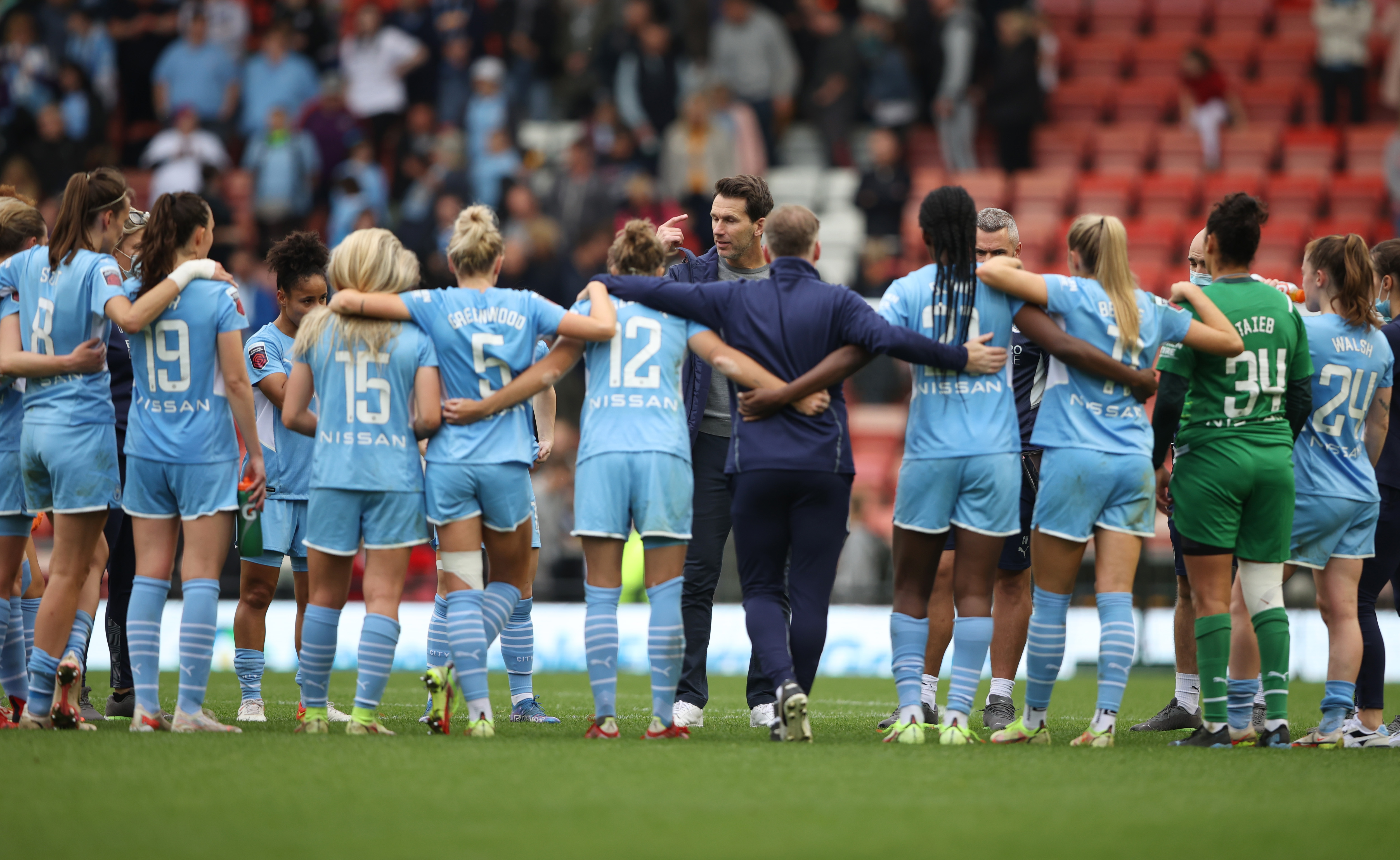 Soccer Football - Women's Super League - Manchester United v Manchester City - Leigh Sports Village, Britain - October 9, 2021  Manchester City players and staff huddle after the match Action Images via Reuters/Molly Darlington