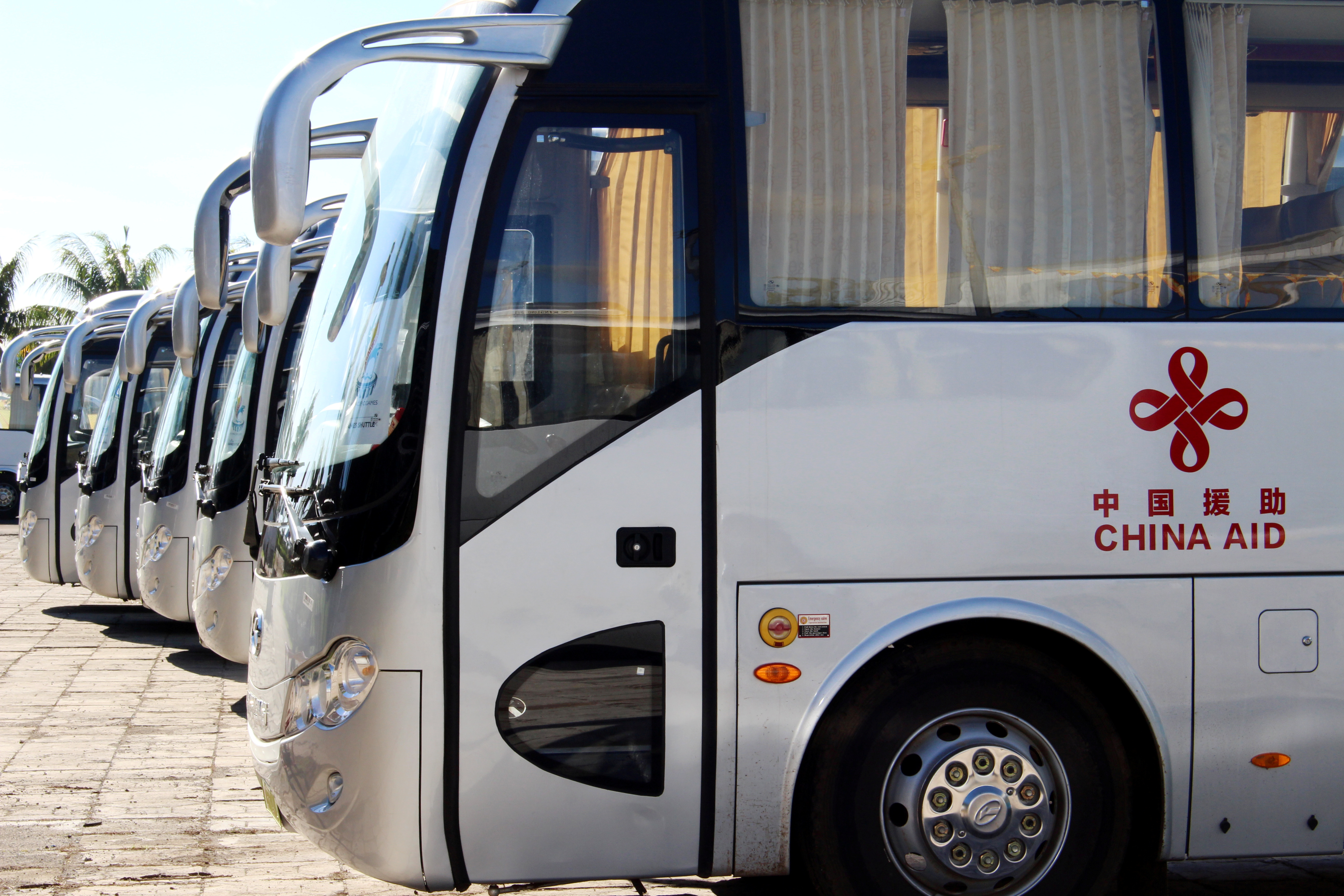 Buses gifted from China for the Pacific Games are parked at a Beijing-refurbished aquatic centre in Apia, Samoa, July 12, 2019. Picture taken July 12, 2019. REUTERS/Jonathan Barrett/File Photo
