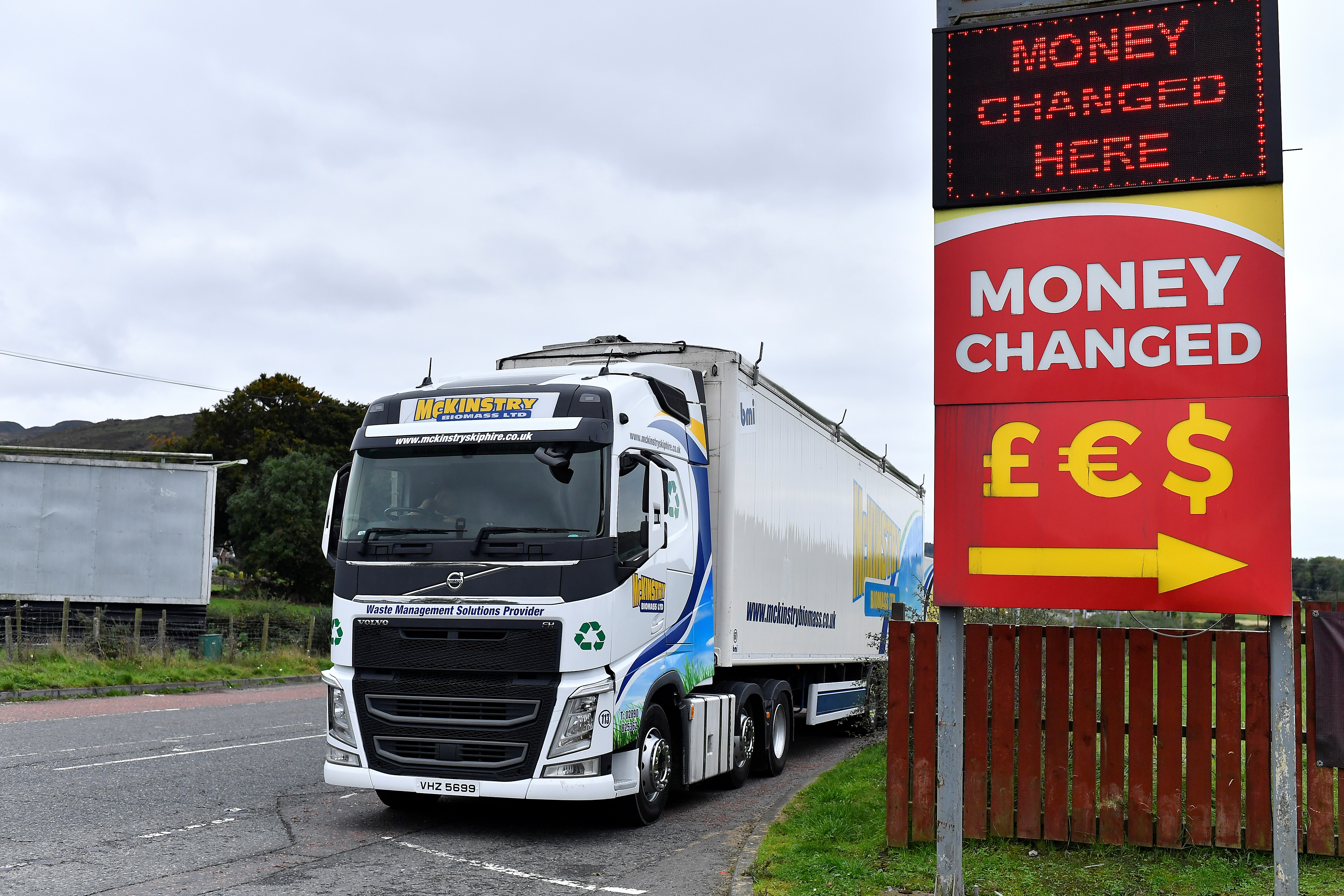 A truck parked beside a 'money changed' sign is seen on the border between Northern Ireland and the Republic of Ireland near Jonesborough, Northern Ireland, October 13, 2021. REUTERS/Clodagh Kilcoyne