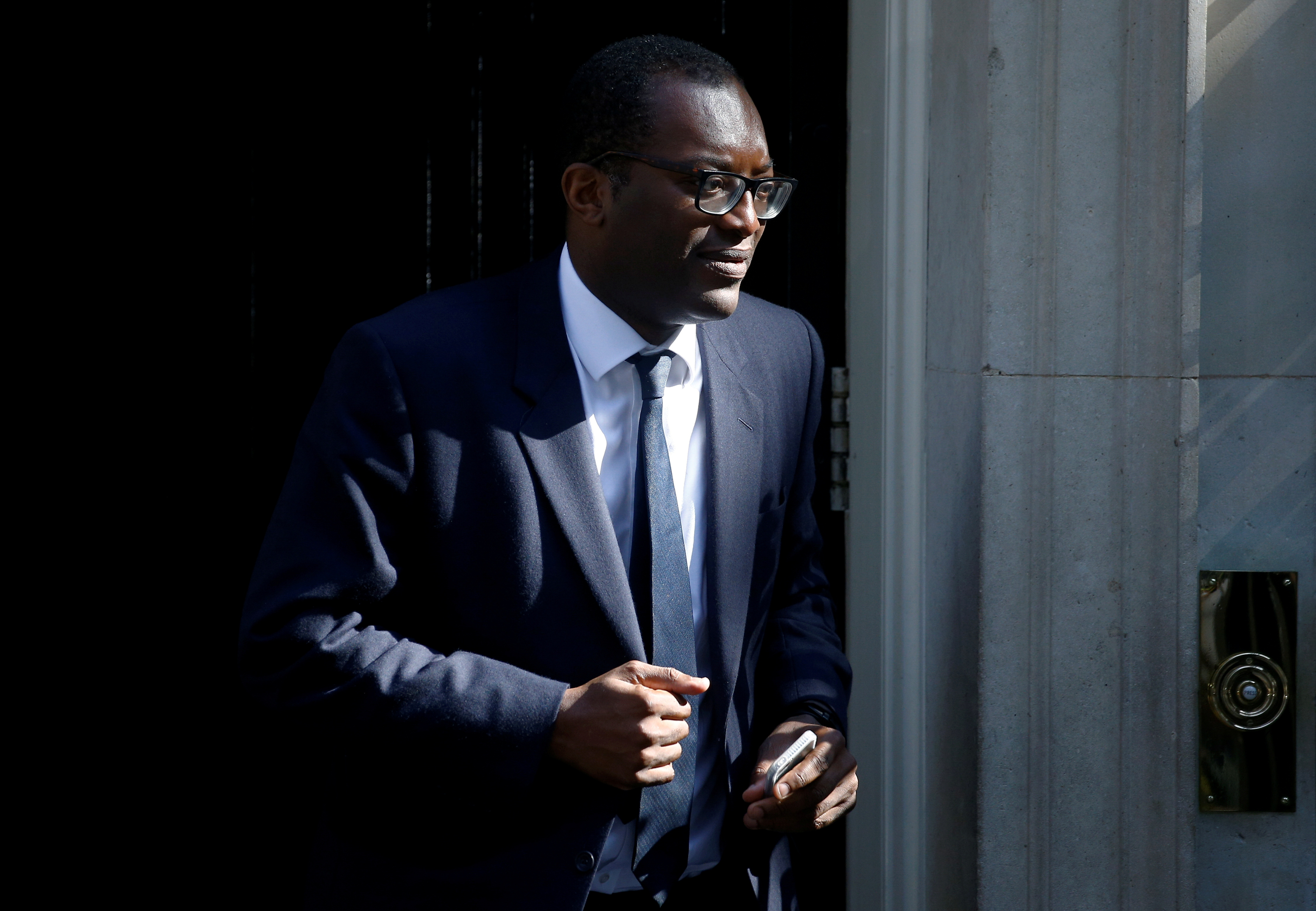 Newly appointed Britain's Minister of State at the Department for Business, Energy and Industrial Strategy, Kwasi Kwarteng, is seen outside Downing Street in London, Britain July 25, 2019. REUTERS/Henry Nicholls/File Photo