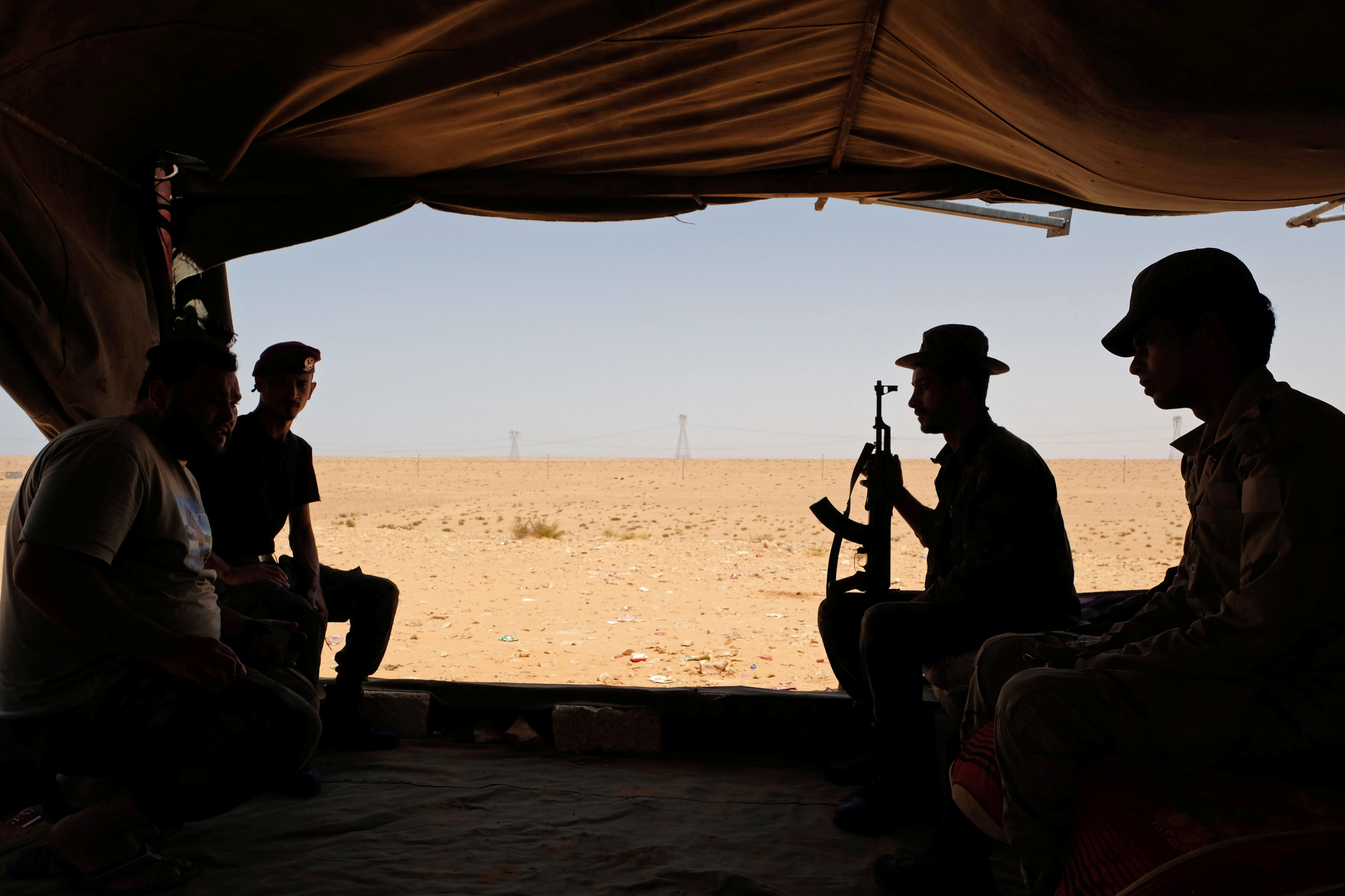 Members of the Libyan National Army (LNA) commanded by Khalifa Haftar sit inside a tent at one their sites in west of Sirte, Libya August 19, 2020. REUTERS/Esam Omran Al-Fetori