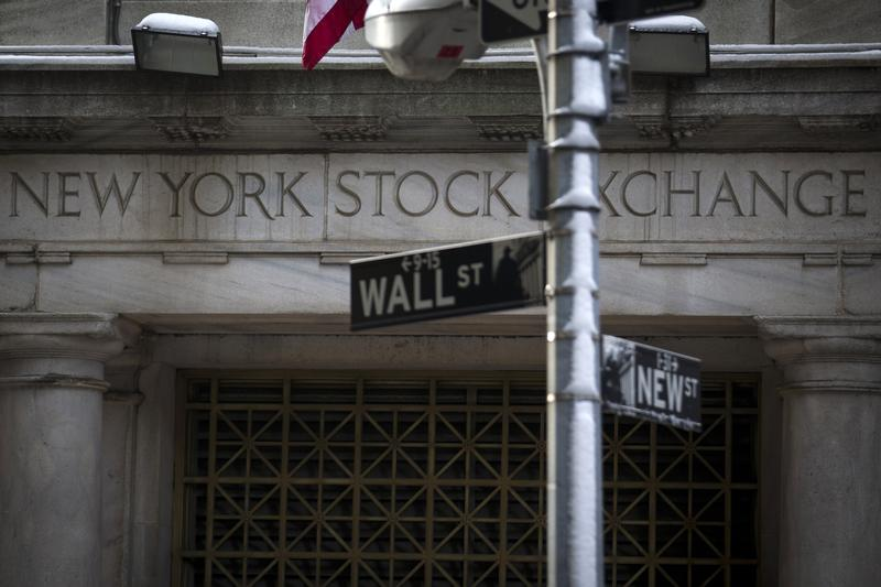 The Wall St. sign is seen outside the door to the New York Stock Exchange in New York's financial district February 4, 2014.   REUTERS/Brendan McDermid (UNITED STATES - Tags: BUSINESS) - GM1EA25038Q01