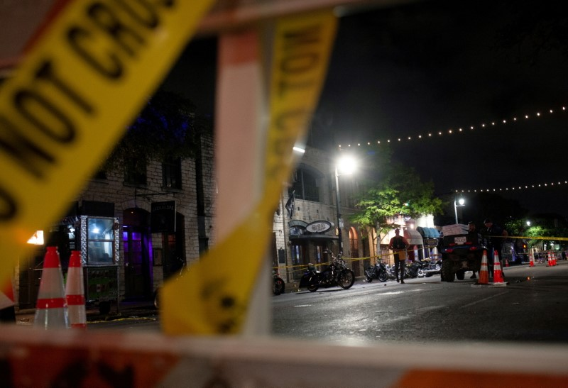 Police investigate the scene of a mass shooting in the Sixth Street entertainment district area of Austin, Texas, U.S. June 12, 2021. REUTERS/Nuri Vallbona/File Photo