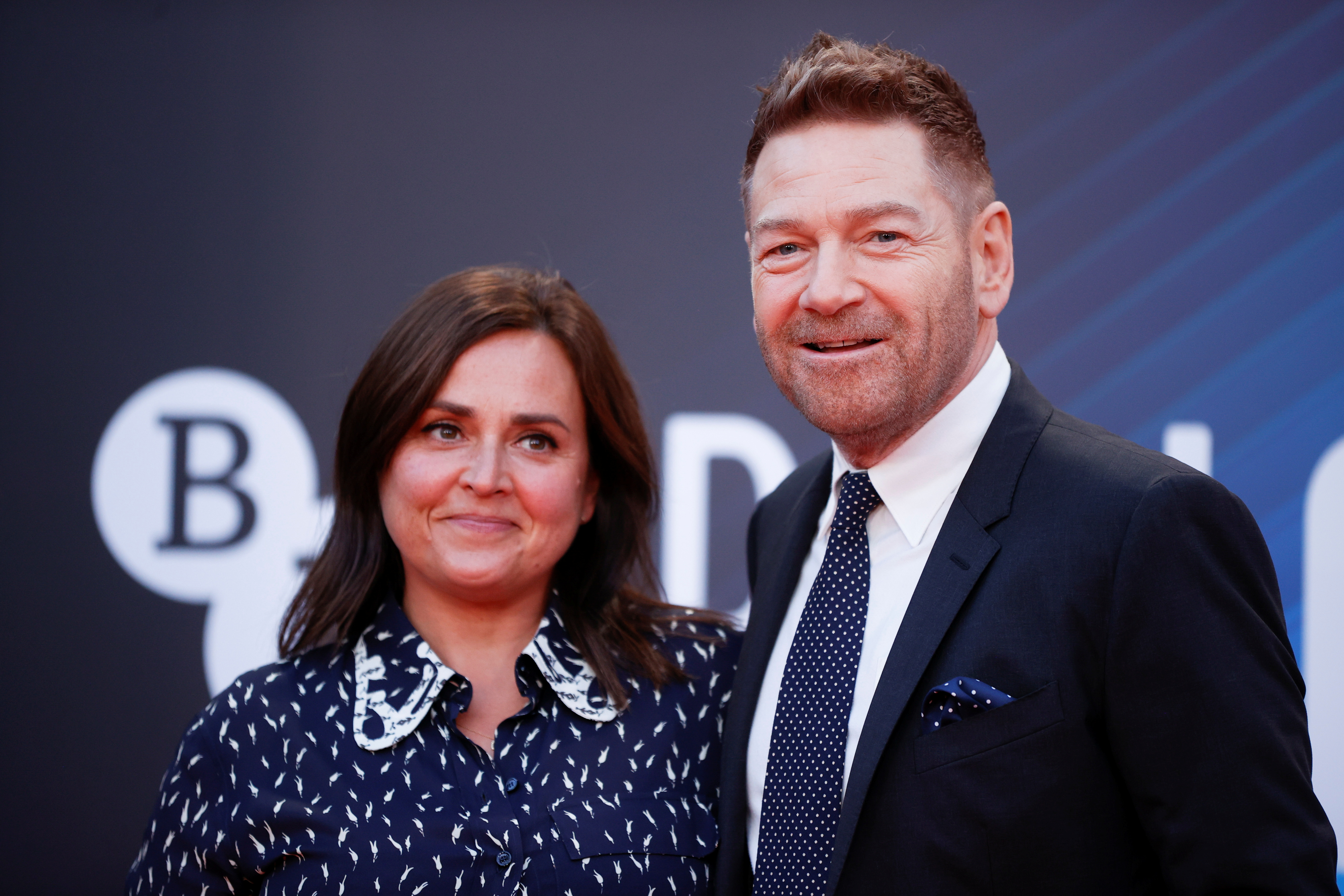 Director Kenneth Branagh and his wife Lindsay Brunnock arrive at a screening of the film