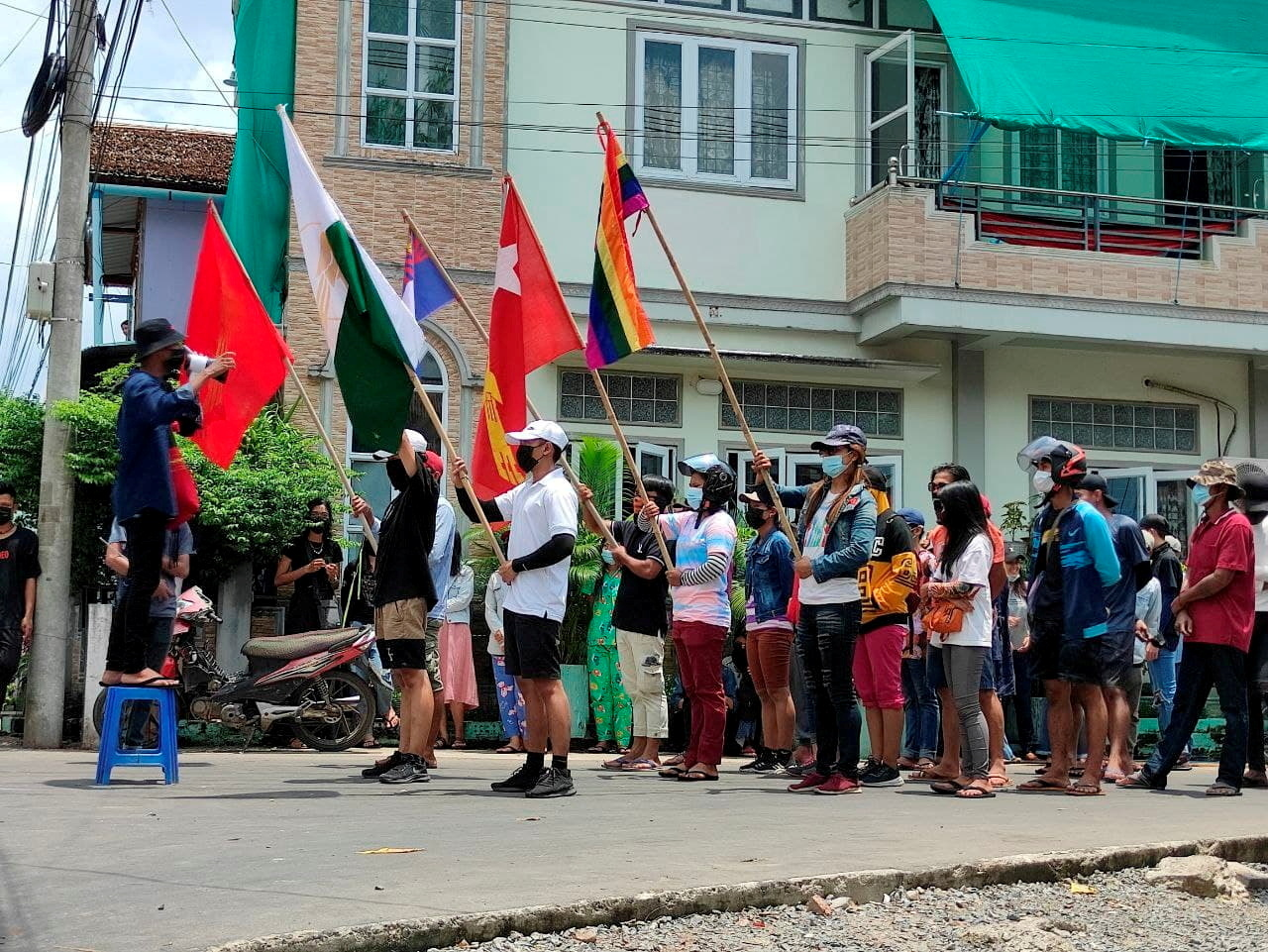 Demonstrators carry flags during a protest against the military coup, in Dawei, Myanmar, April 27, 2021. Courtesy of Dawei Watch/via REUTERS/File Photo