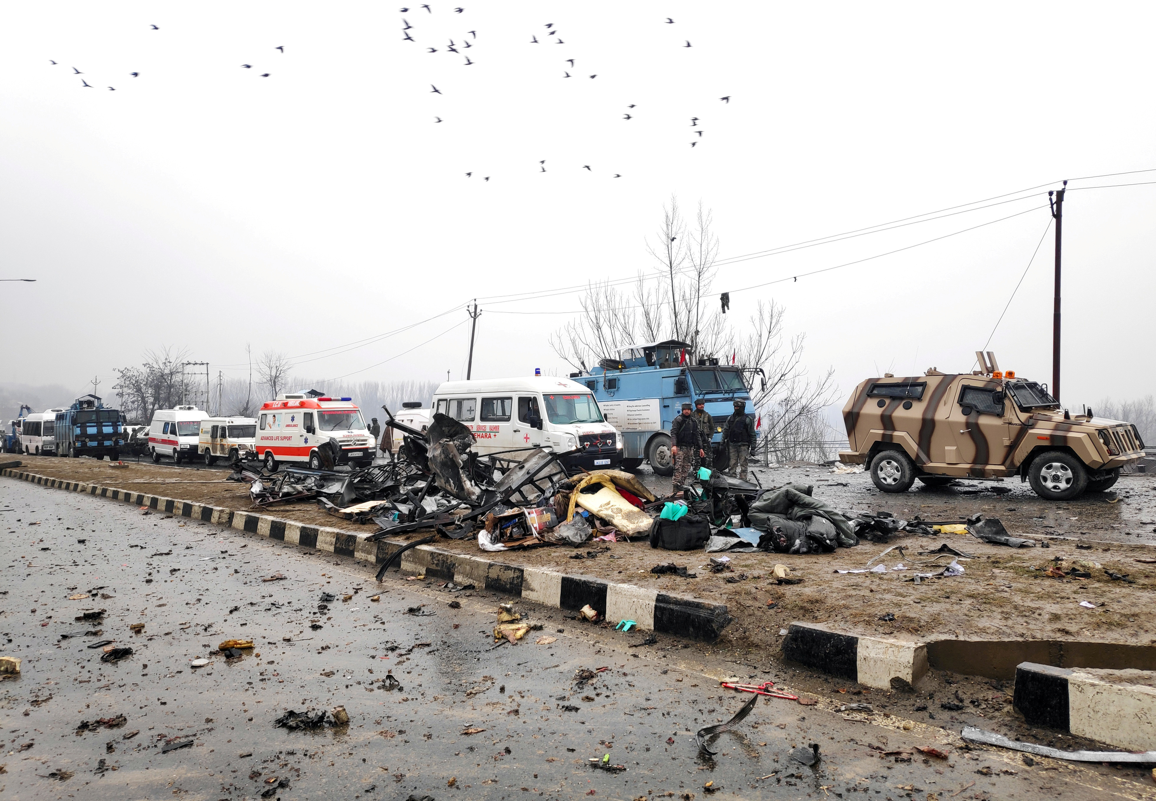 Indian soldiers examine the debris after an explosion in Lethpora in south Kashmir's Pulwama district February 14, 2019. REUTERS/Younis Khaliq/File Photo
