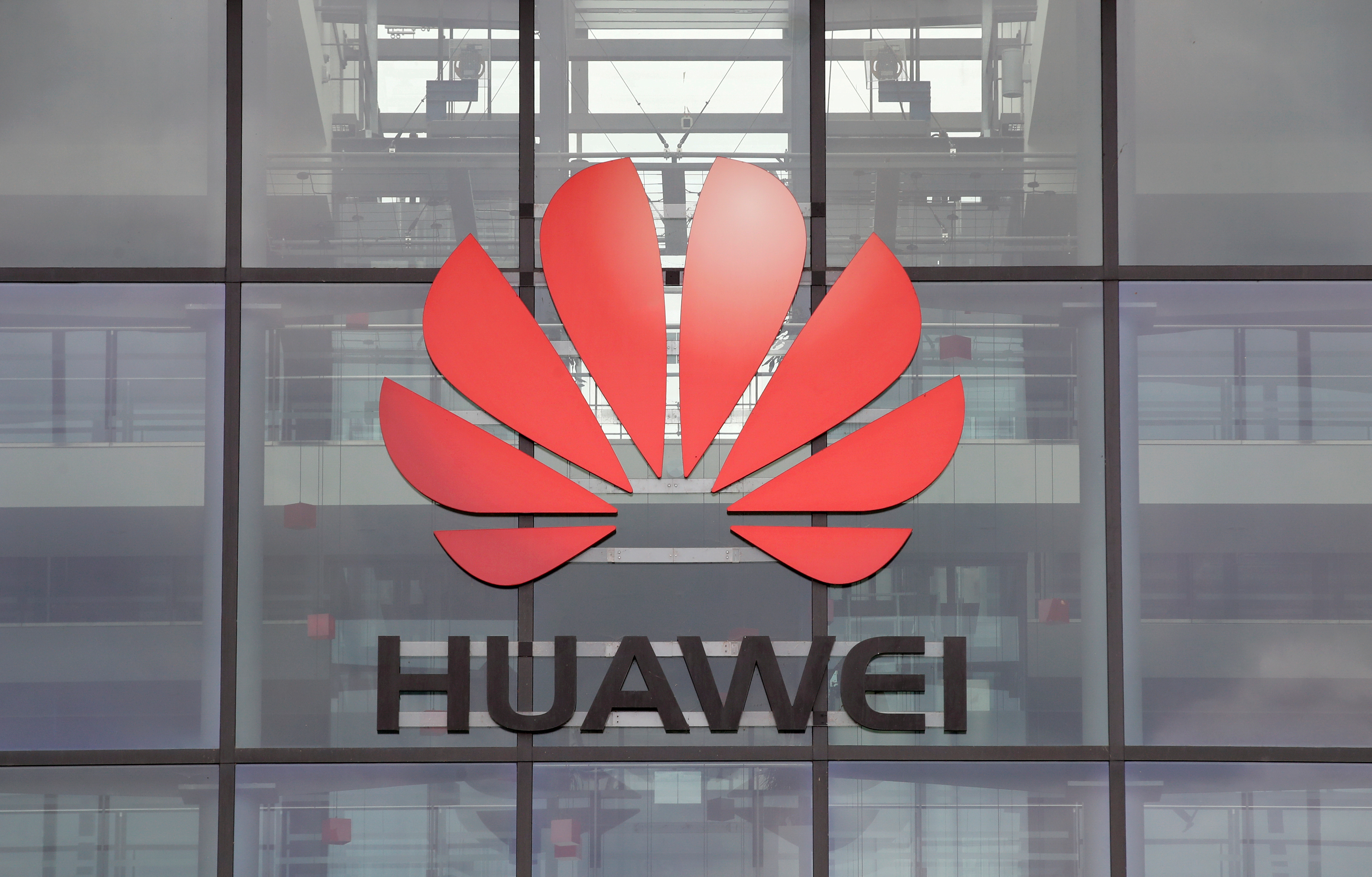 Huawei logo is pictured on the headquarters building in Reading, Britain July 14, 2020. REUTERS/Matthew Childs/File Photo