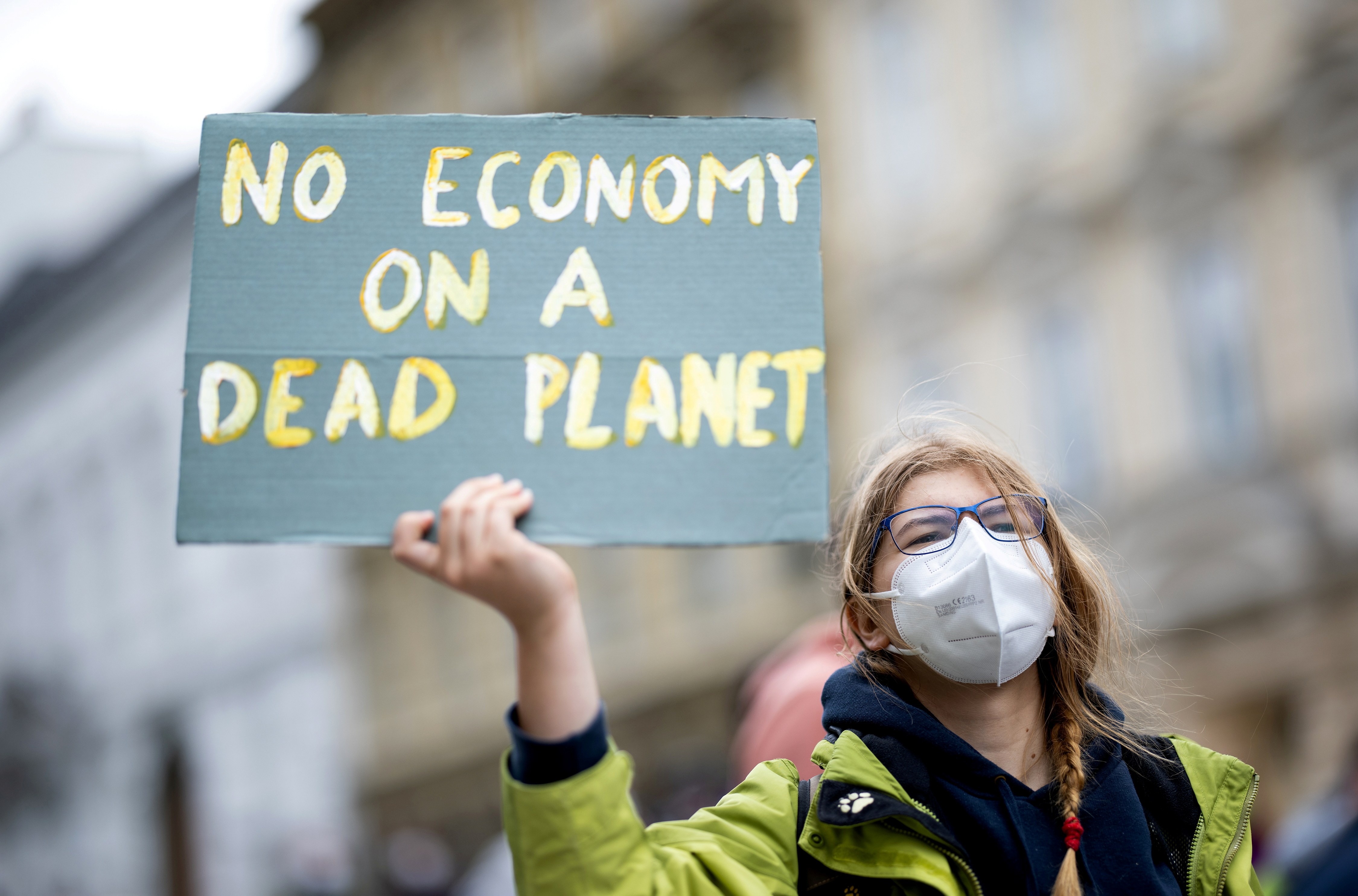 A person takes part in a Fridays for Future protest outside the Austrian Economic Chamber, in Vienna, Austria, May 14, 2021. REUTERS/Lisi Niesner/File Photo