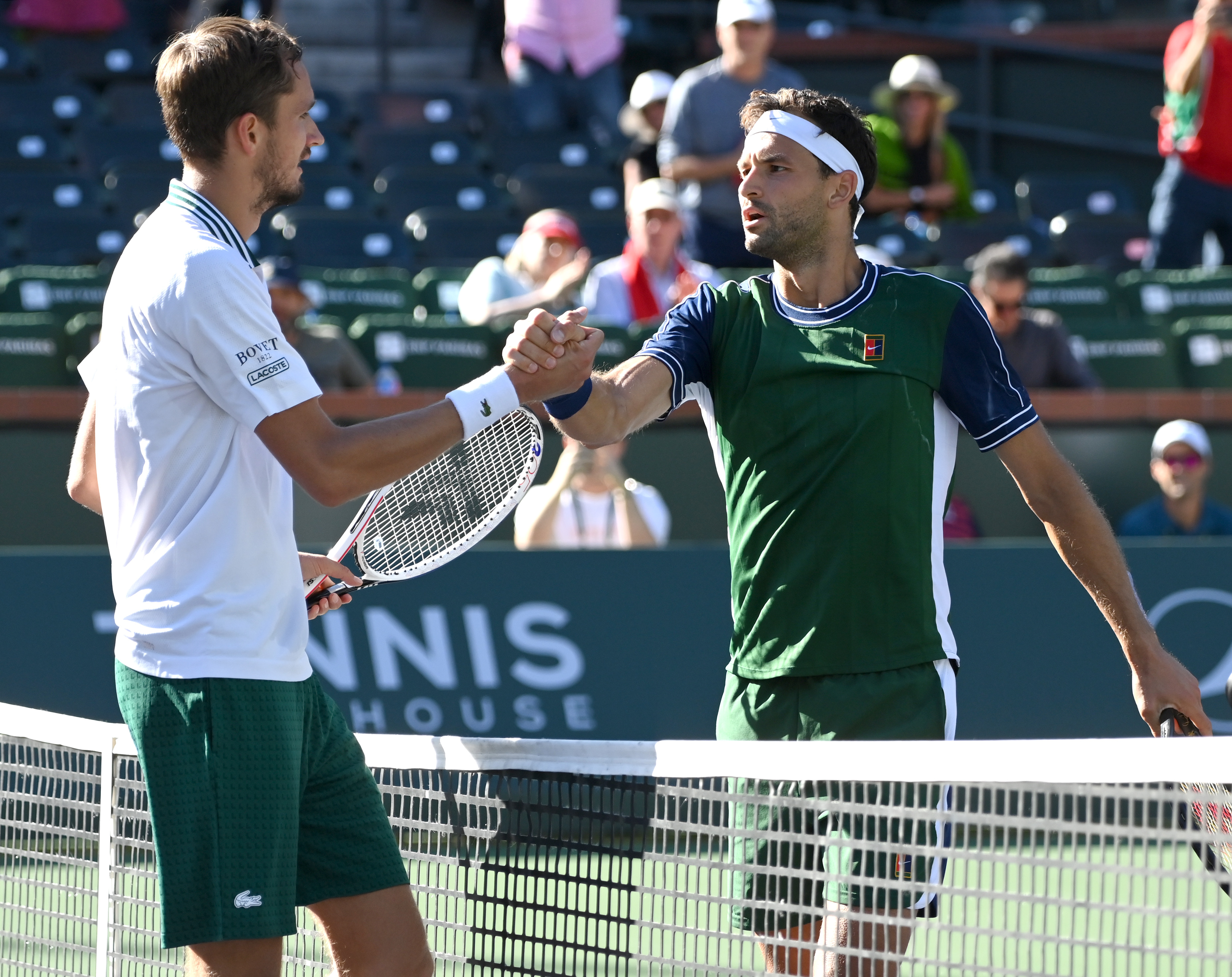 Oct 13, 2021; Indian Wells, CA, USA; Daniil Medvedev (RUS) shakes hands with Grigor Dimitrov (BUL) after their fourth round match during the BNP Paribas Open at the Indian Wells Tennis Garden. Mandatory Credit: Jayne Kamin-Oncea-USA TODAY Sports
