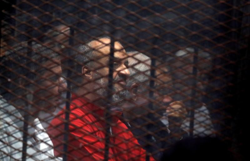 Muslim Brotherhood's senior member Mohamed El-Beltagi sits behind the bars during a court session in Cairo, Egypt, December 2, 2018. REUTERS/Amr Abdallah Dalsh/File Photo