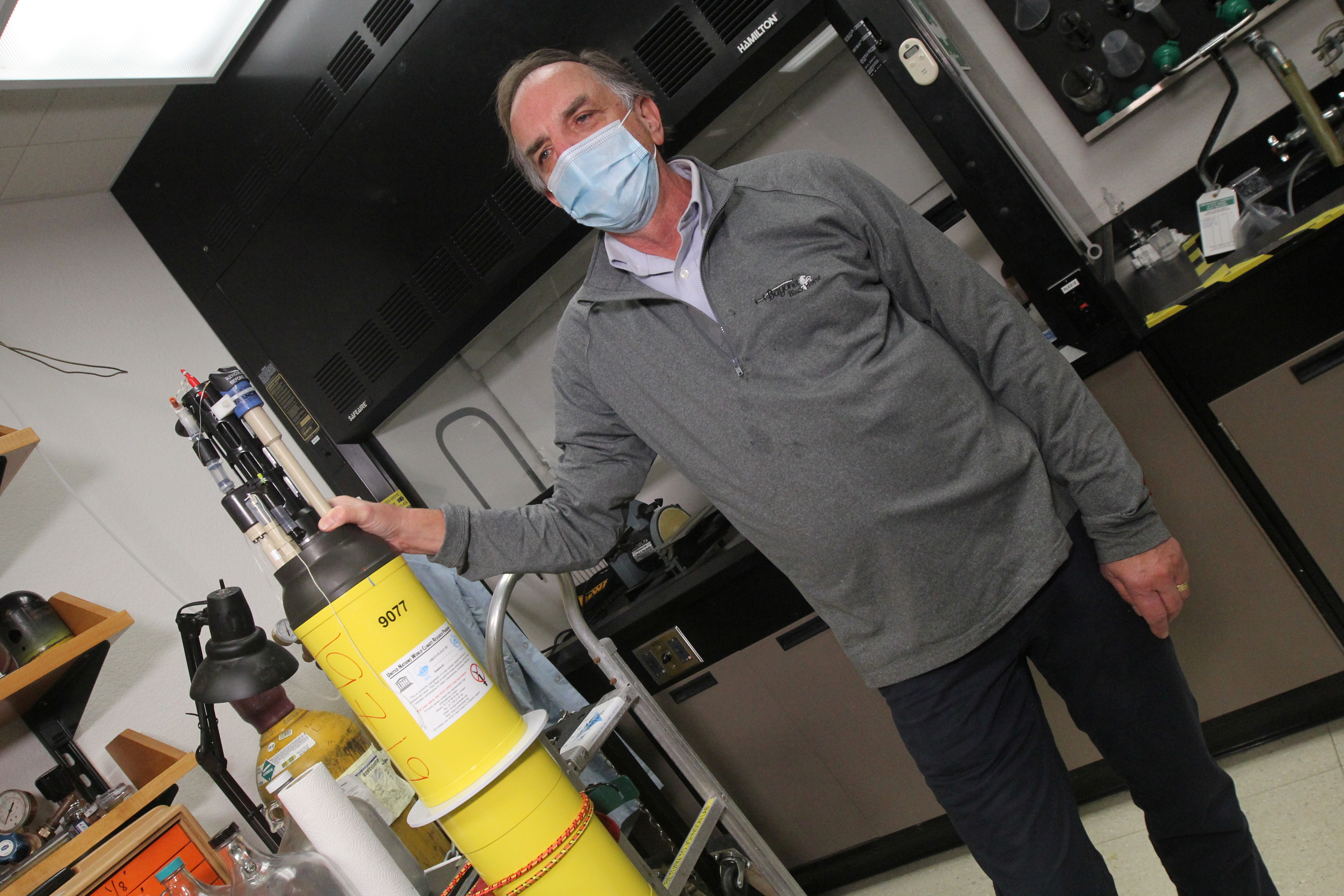 Ken Johnson, project director of the Global Ocean Biogeochemistry Array, stands next to a robotic ocean float in a laboratory at the Monterey Bay Aquarium Research Institute in Moss Landing, California, U.S. on March 9, 2021. Picture taken March 9, 2021. REUTERS/Nathan Frandino